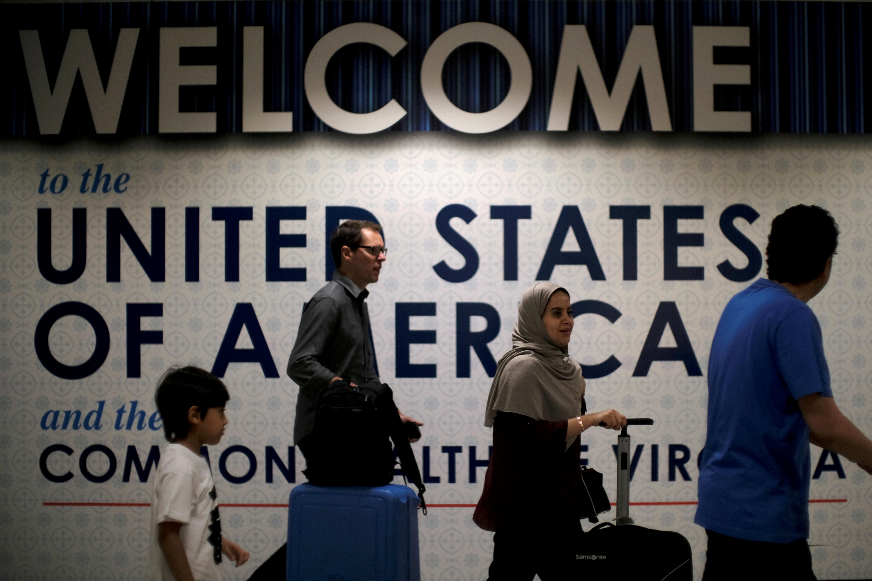 FILE PHOTO: International passengers arrive at Washington Dulles International Airport in Dulles