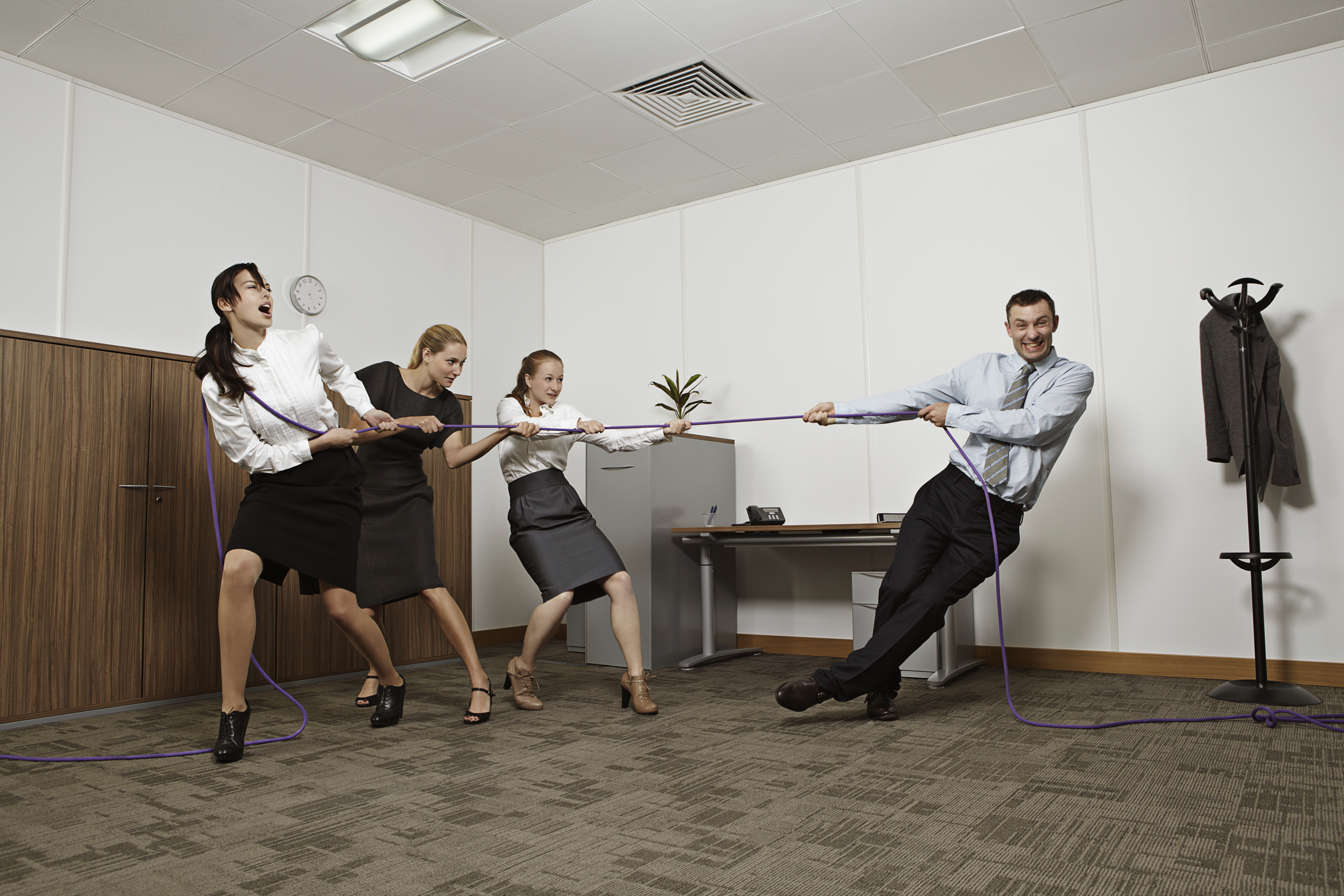Coworkers playing tug-of-war