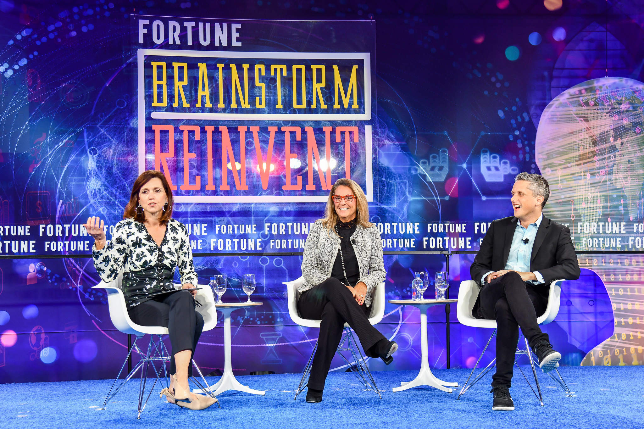 Moderator Beth Comstock (L), co-chair of Fortune's Brainstorm Reinvent conference, speaks with Melanie Kalmar, corporate vice president, chief information officer, and chief digital officer of Dow Chemical, and Aaron Levie, co-founder, chairman, and CEO of Box, at the conference in Chicago on Sept. 25, 2018.