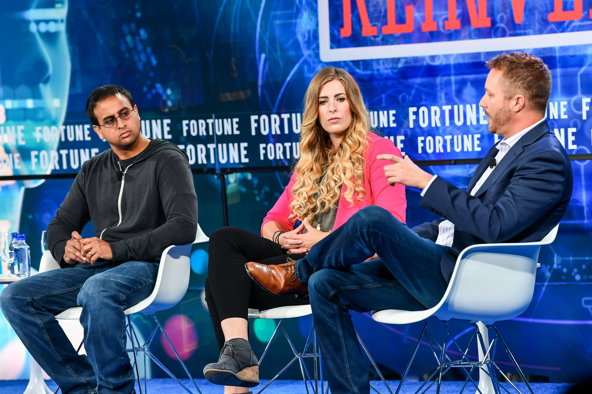 Amol Deshpande, co-founder and CEO of Farmers Business Network, Megz Reynolds, farmer at LPG Farms, and Mark Young, chief technology officer at the Climate Corporation, speaking at the Fortune Brainstorm Reinvent conference on Sept. 25, 2018, in Chicago.