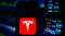 Tesla Inc logo is seen on an android mobile phone
