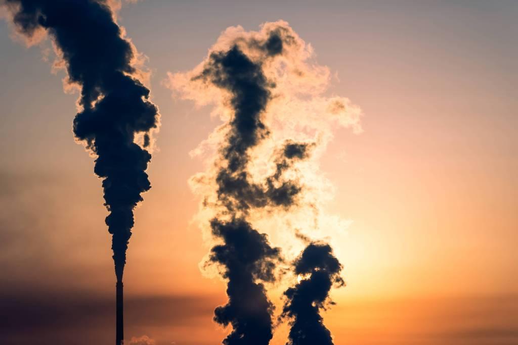 An industrial smokestack in silhouette in Zhangjiakou, Hebei, China.
