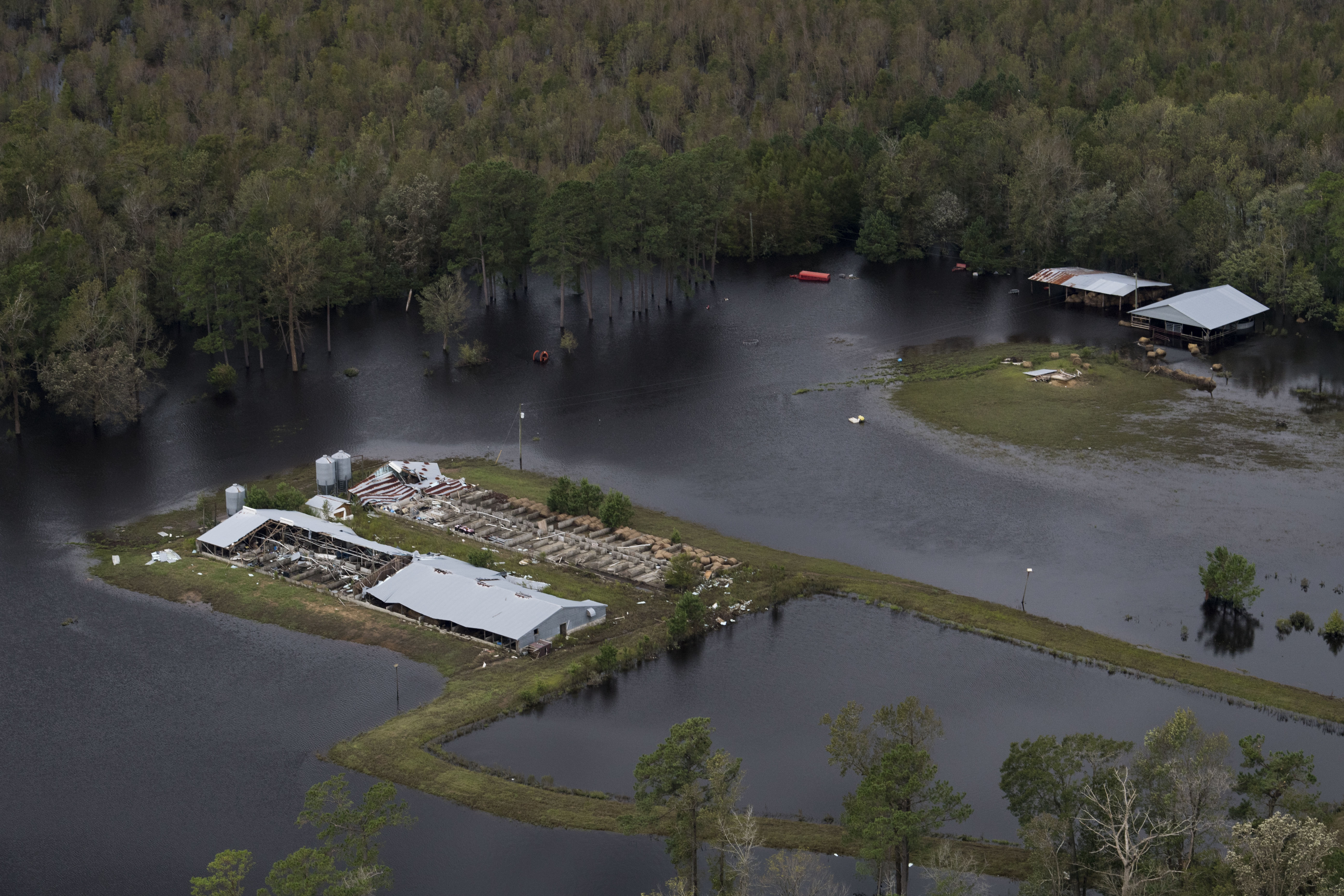 Flooding and wind damage from Hurricane Florence is seen on farmland near Half Moon, NC on Sept. 17, 2018.