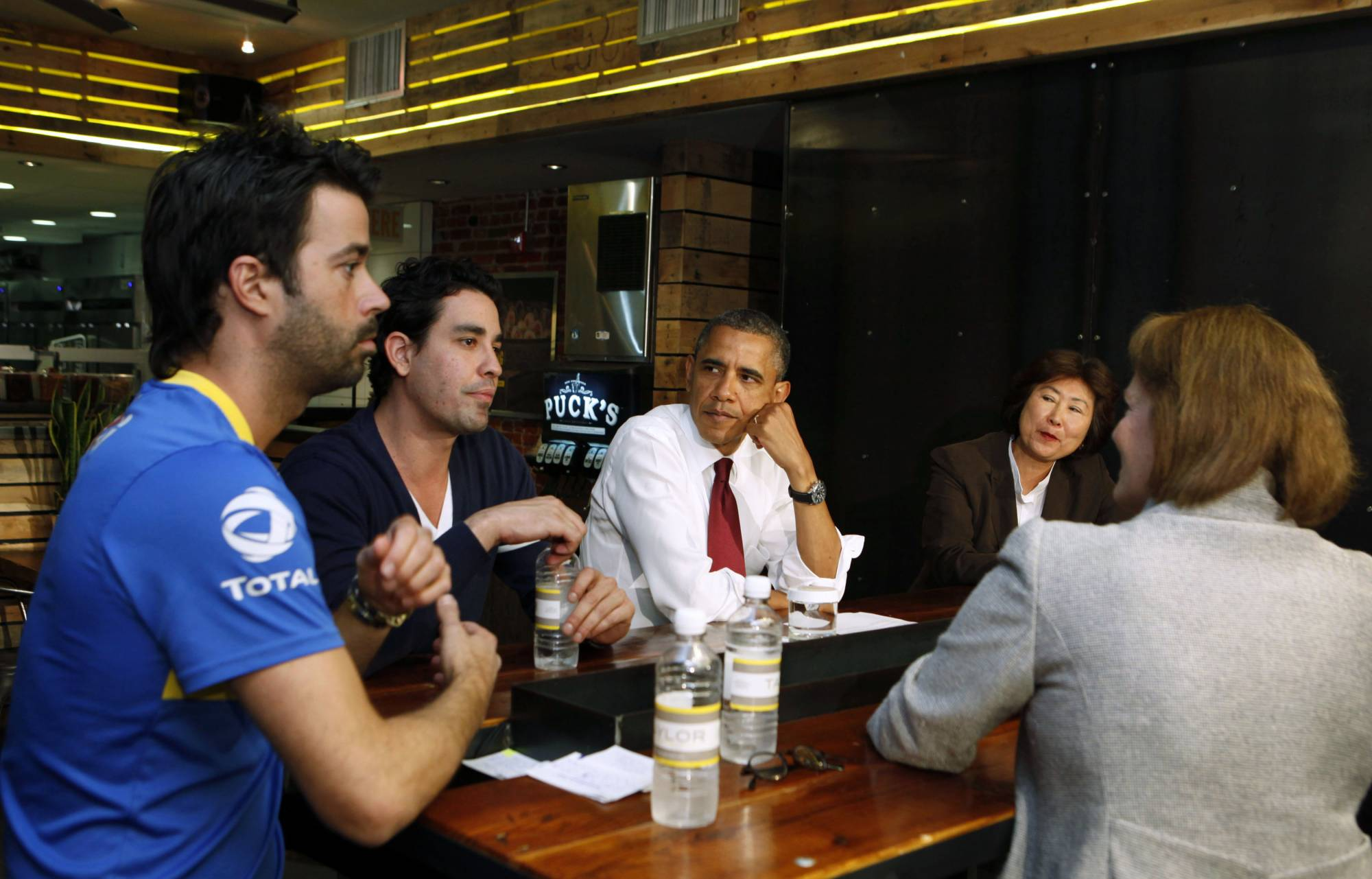 U.S. President Obama talks with small business owners to discuss income tax credits in Washington