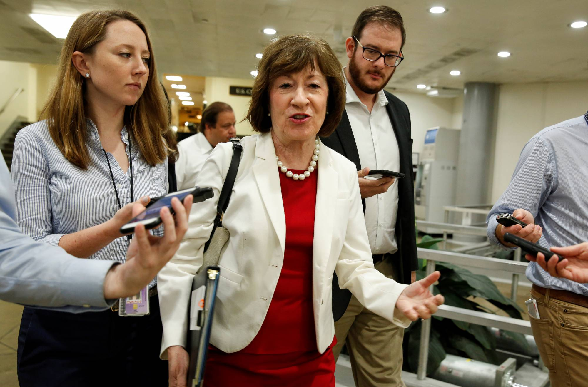 Senator Susan Collins (R-ME) speaks with reporters as she walks at the U.S. Capitol in Washington