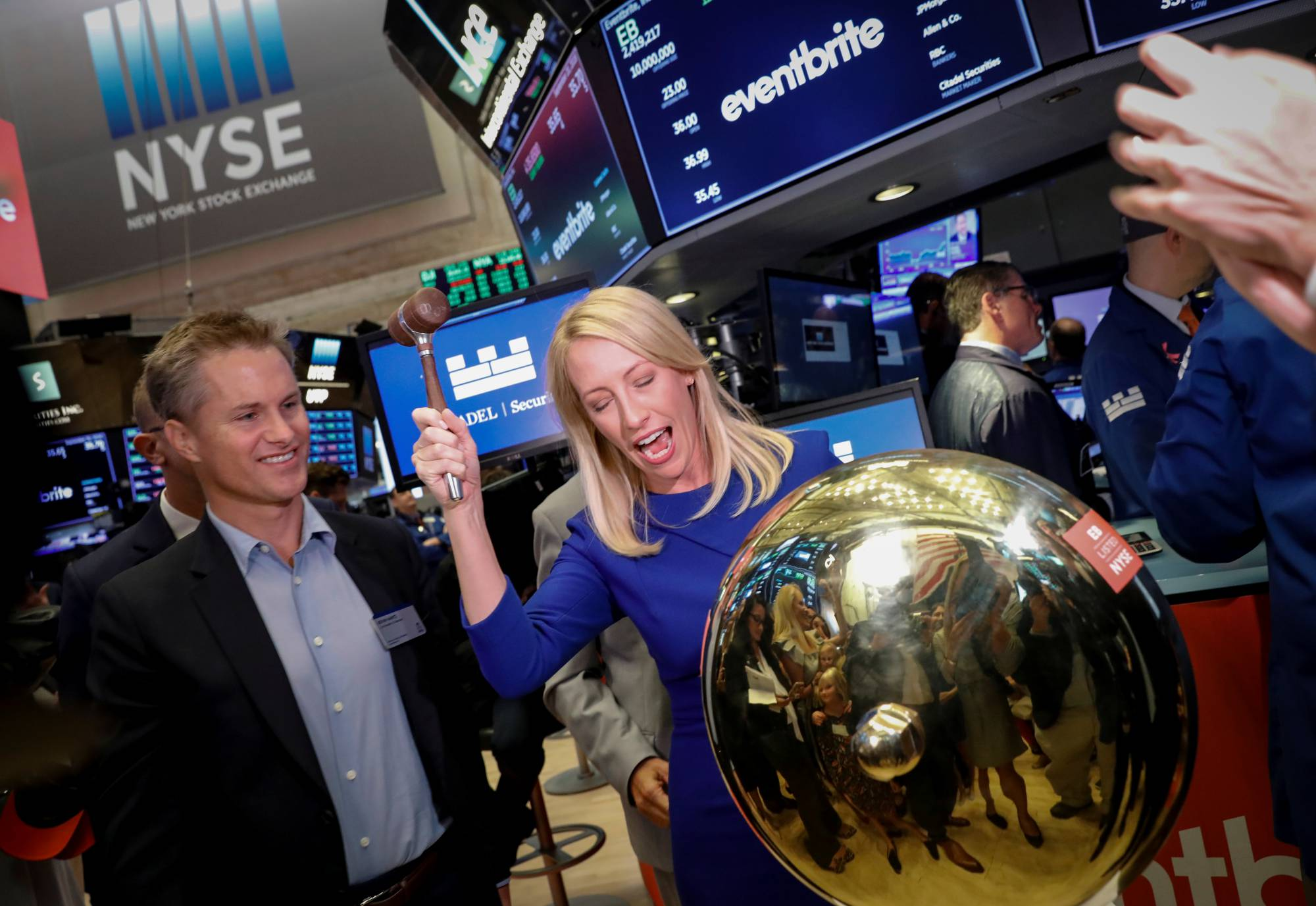 Eventbrite Inc. CEO Julia Hartz stands next to her husband Kevin Hartz, Co-Founder and Chairman of Eventbrite, as she rings a ceremonial bell to celebrate their company's IPO at the NYSE in New York