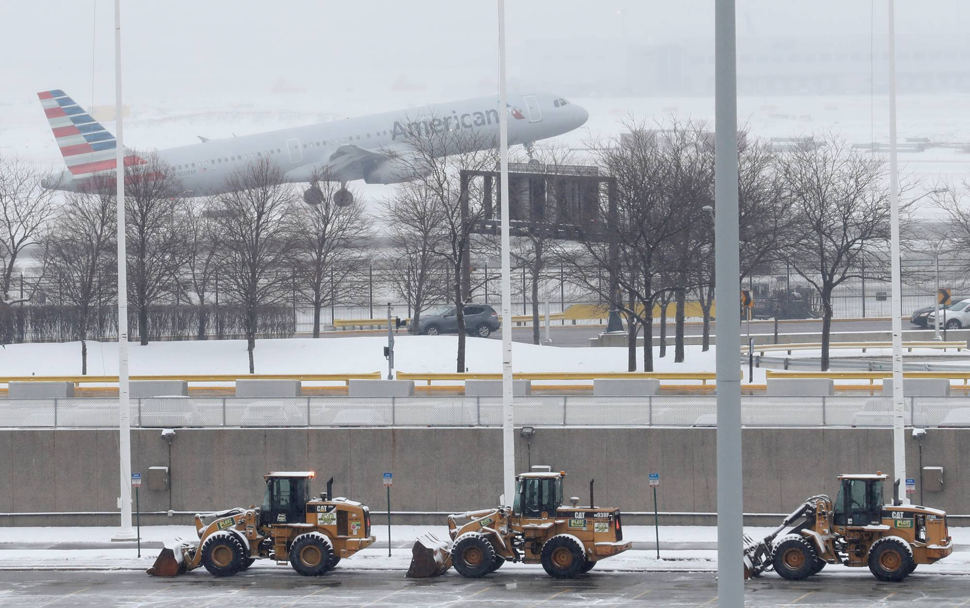 An American Airlines plane departs during the snowstorm at O'Hare International Airport in Chicago