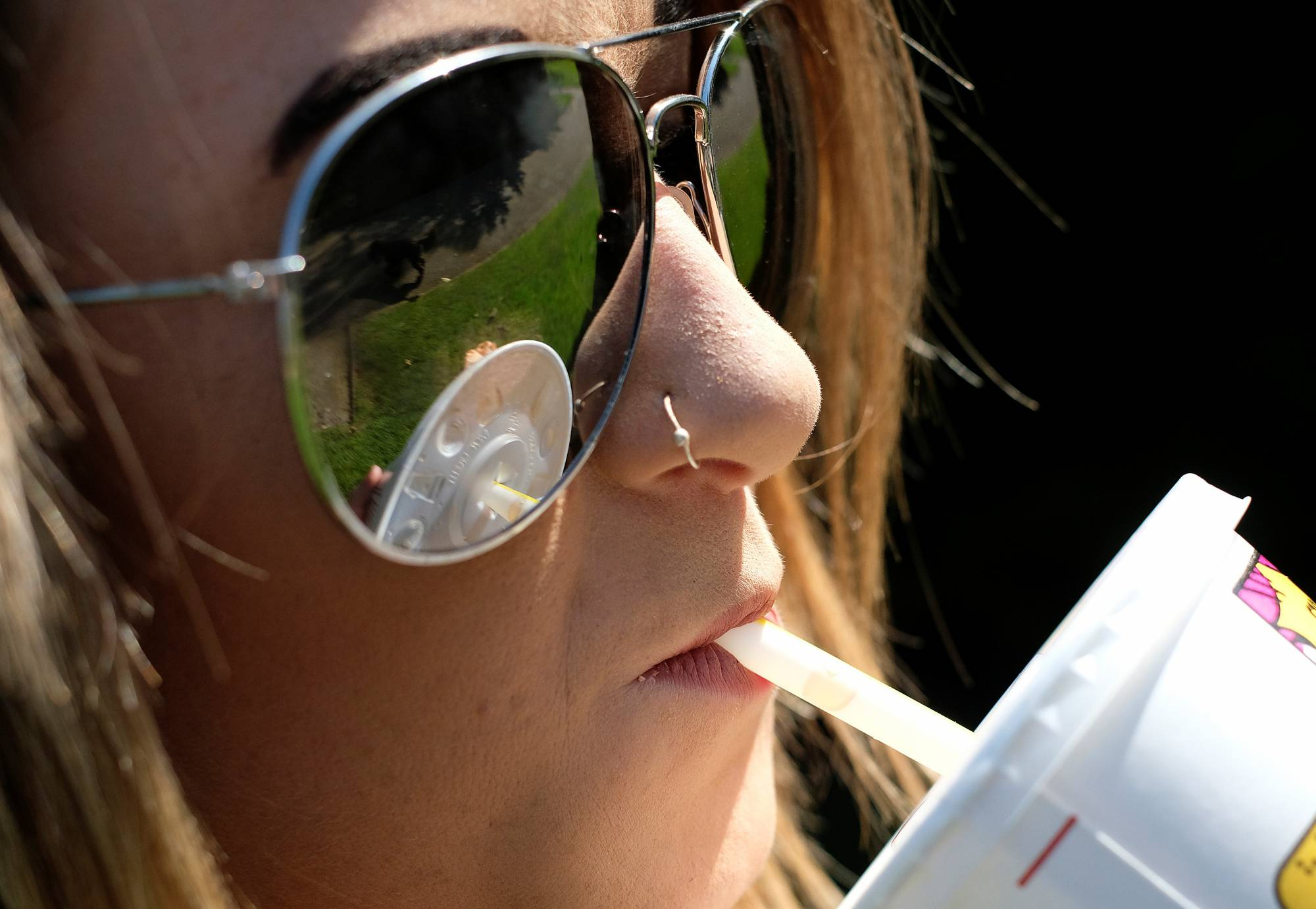 A woman drinks a McDonalds refreshment with a straw in Loughborough
