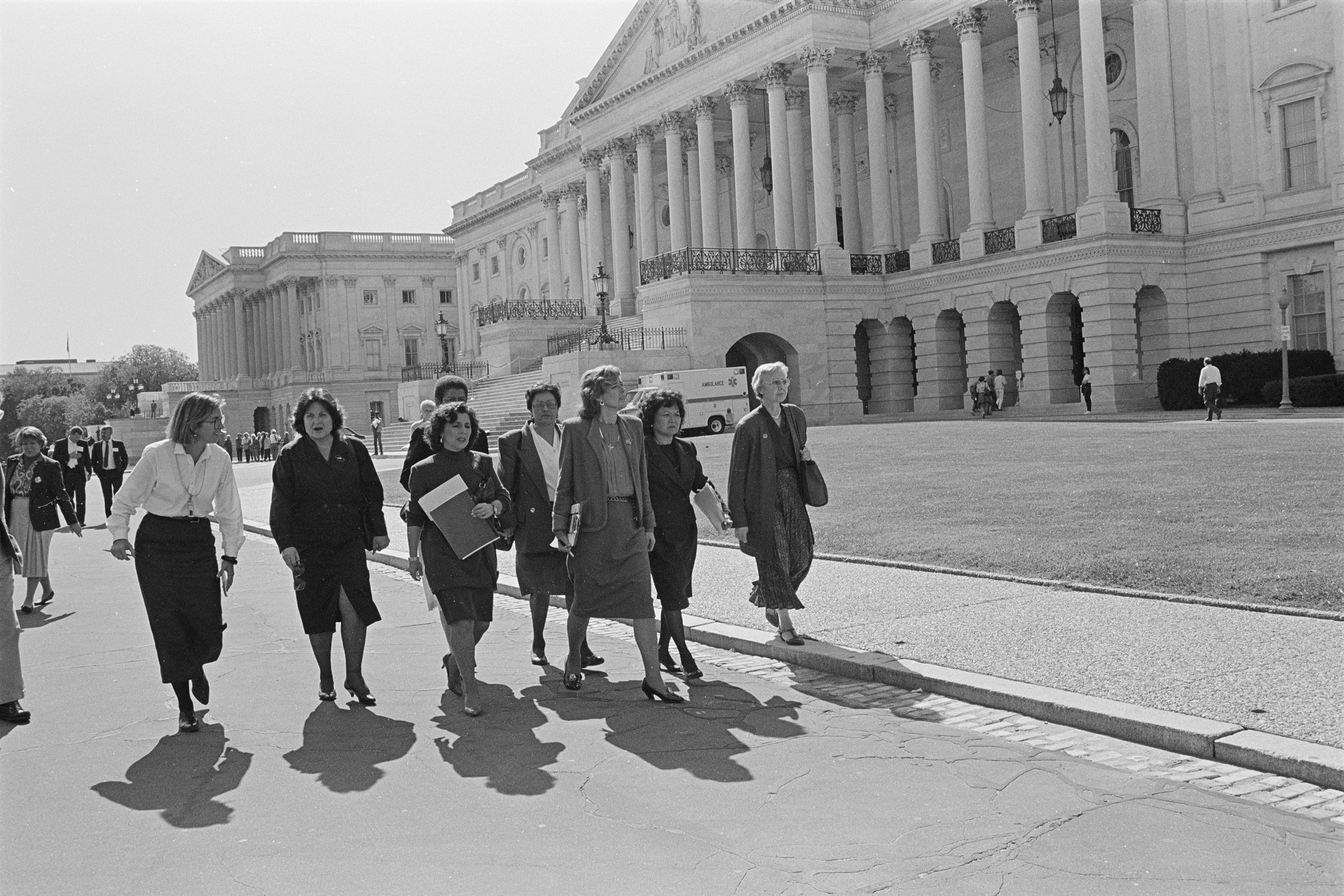 U.S. Representatives including Nita Lowey, Pat Schroeder, Patsy Mink, Jolene Unsoeld, Eleanor Holmes Norton and Ileana Ros-Lehtinen walking by the U.S. Capitol on their way to the Senate in 1991.