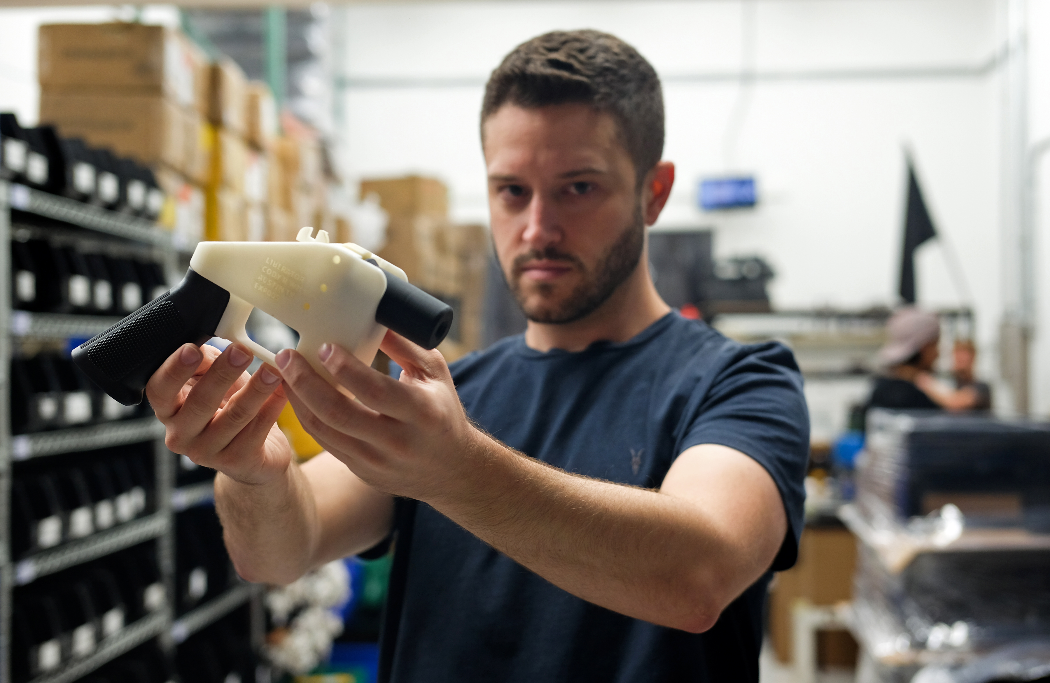 Cody Wilson, owner of Defense Distributed, holds a 3D-printed gun in his factory in Austin, Texas, on Aug. 1, 2018.