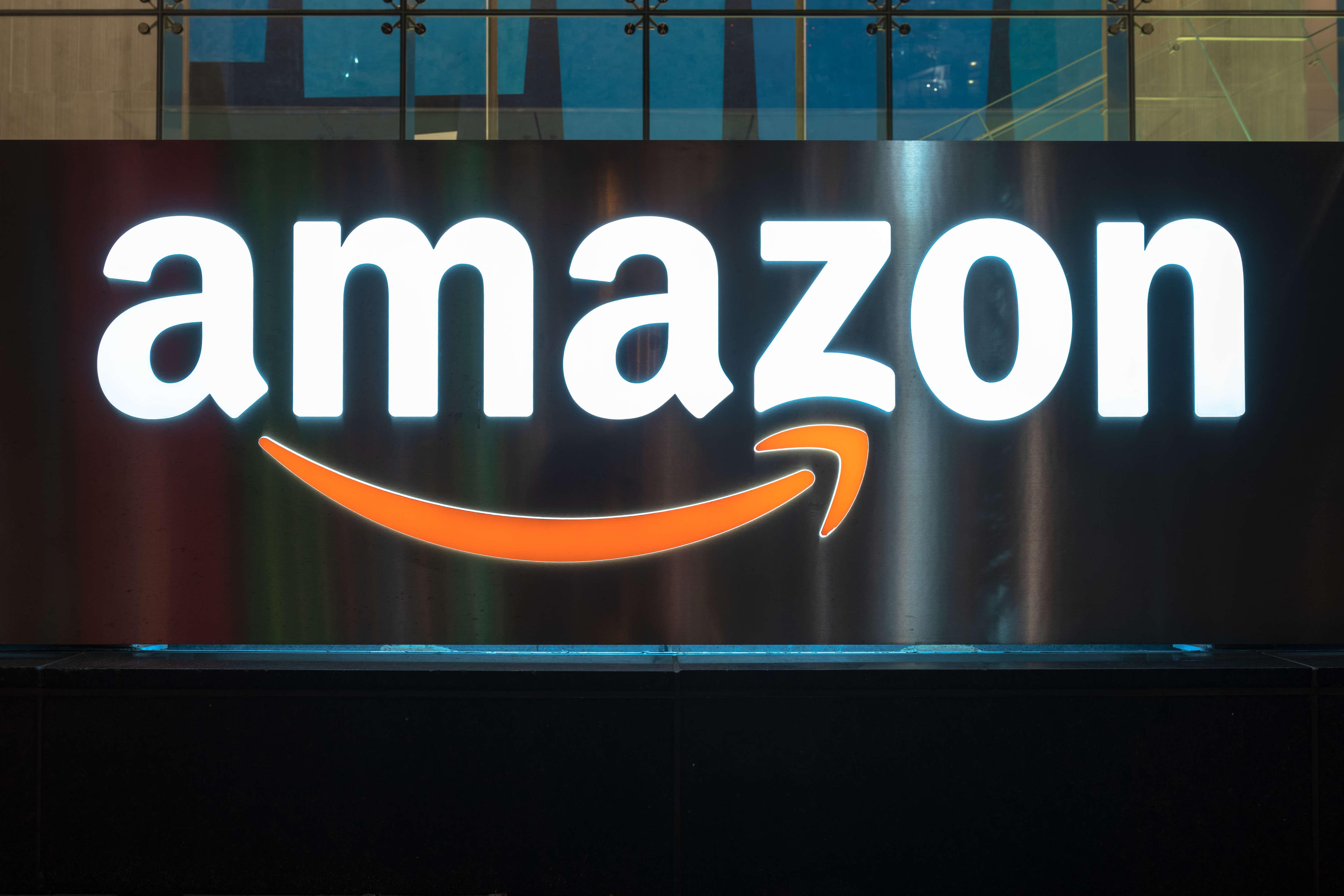 The Amazon logo is illuminated at night in Toronto.