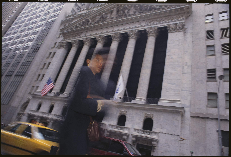 Woman Walks Past the New York Stock Exchange