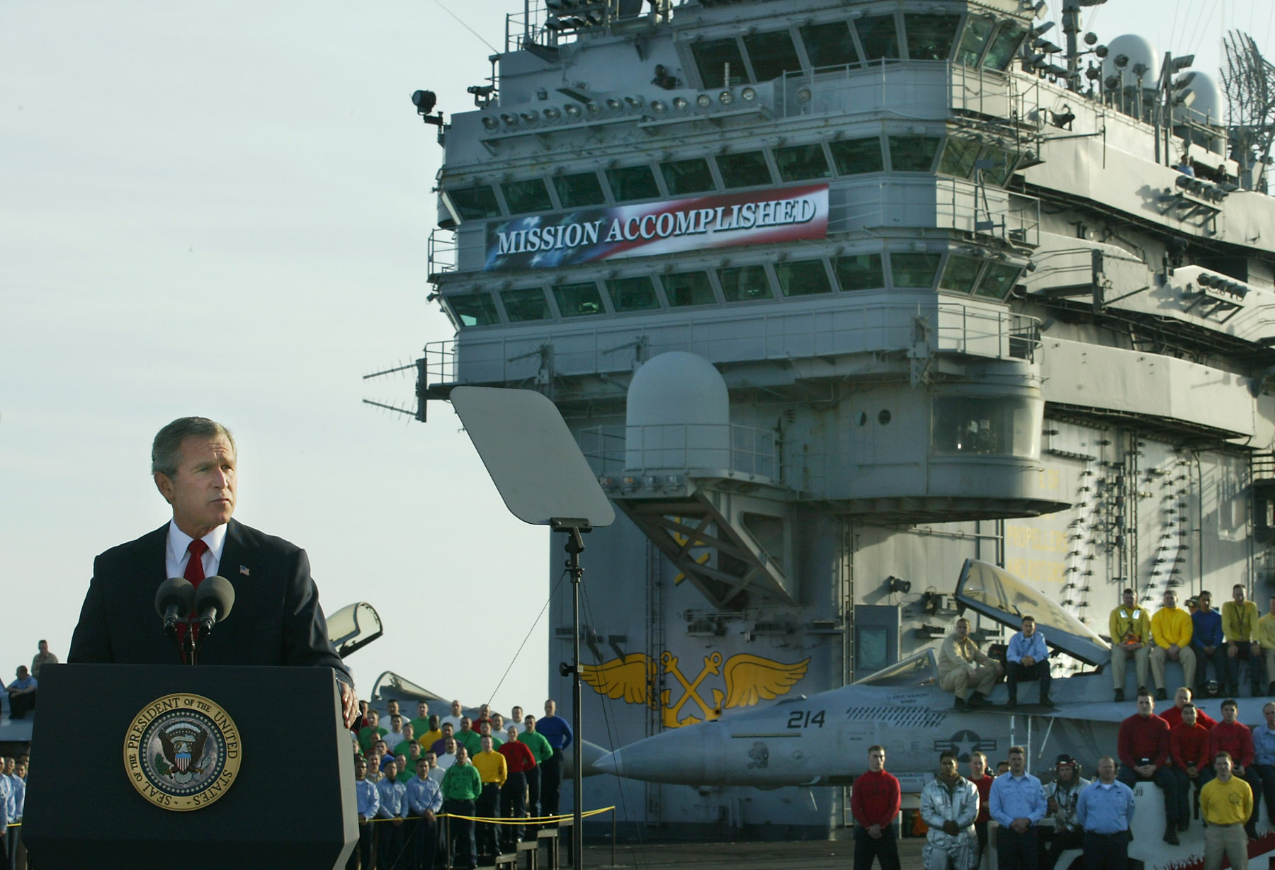 President George W. Bush delivers a speech to on the flight deck of the aircraft carrier USS Abraham Lincoln on May 1, 2003.