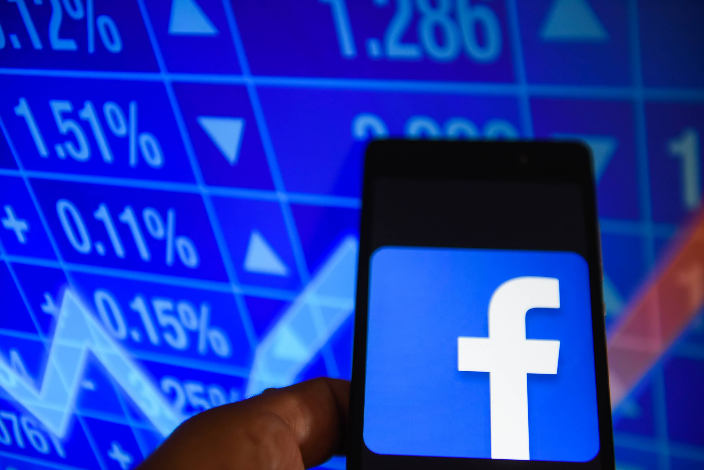 Facebook logo is seen in an Android mobile with  stock