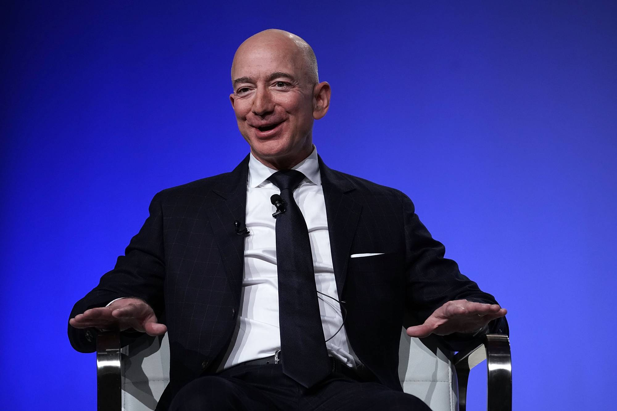 Amazon Chief Jeff Bezos talks DoD contracts and Blue Origin rockets.