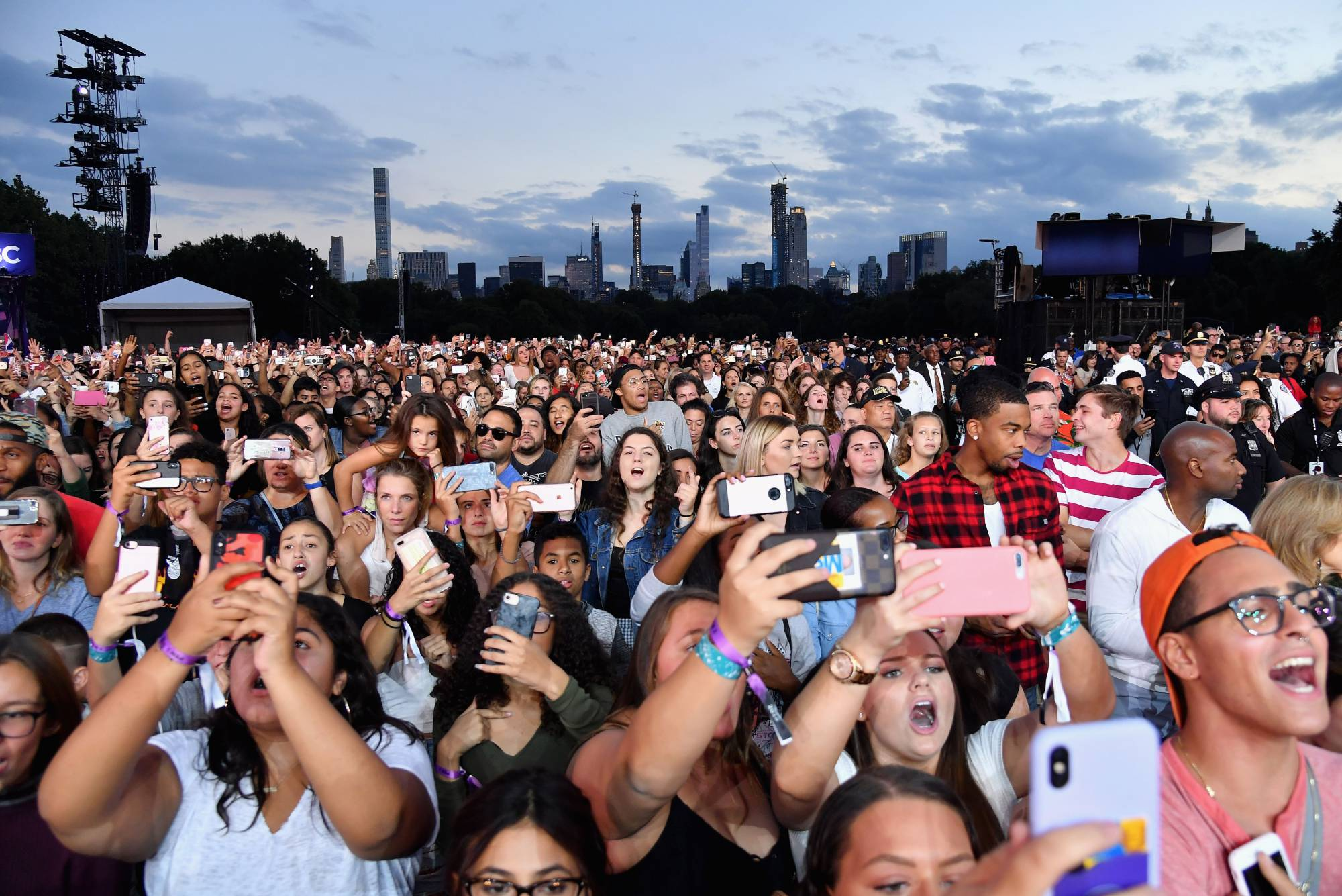 People use their mobile phones during a performance at the 2018 Global Citizen Festival