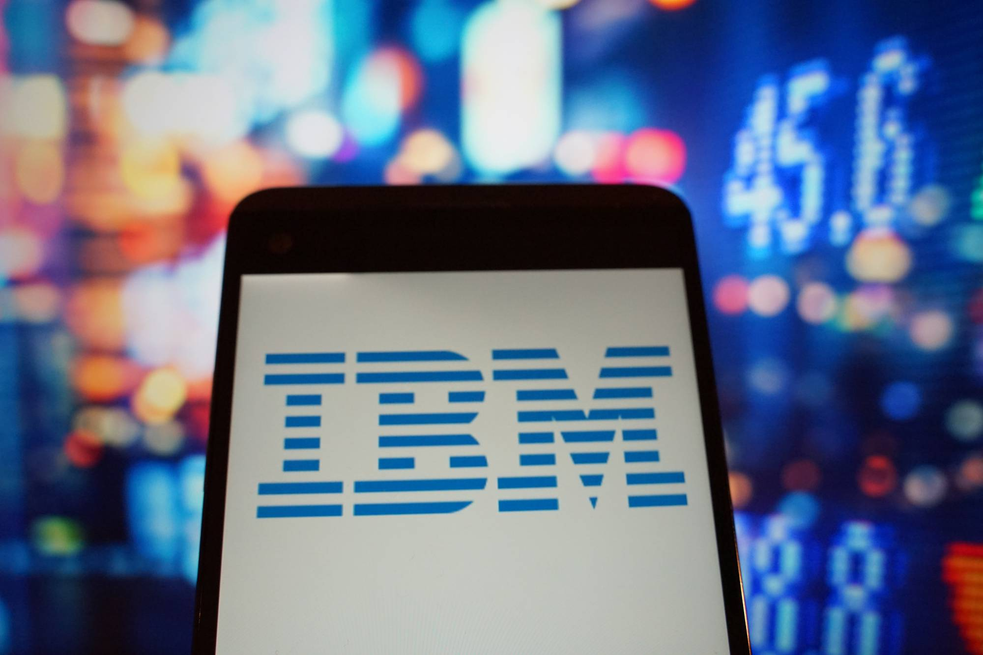 The logo of IBM is seen in a smartphone