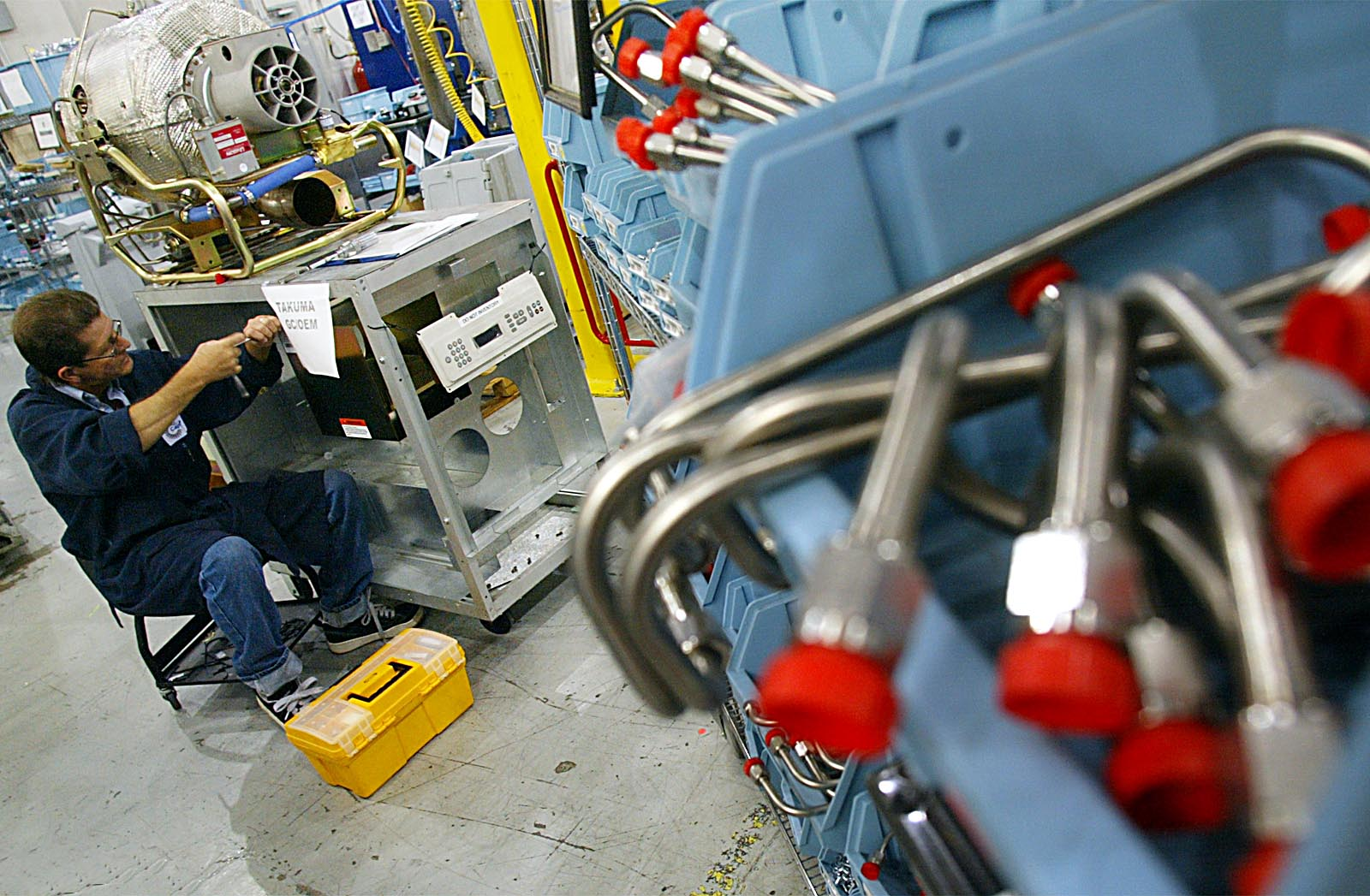 Roberto Paiva assembles a turbine at the Capstone Turbine Corp. plant in Chatsworth.