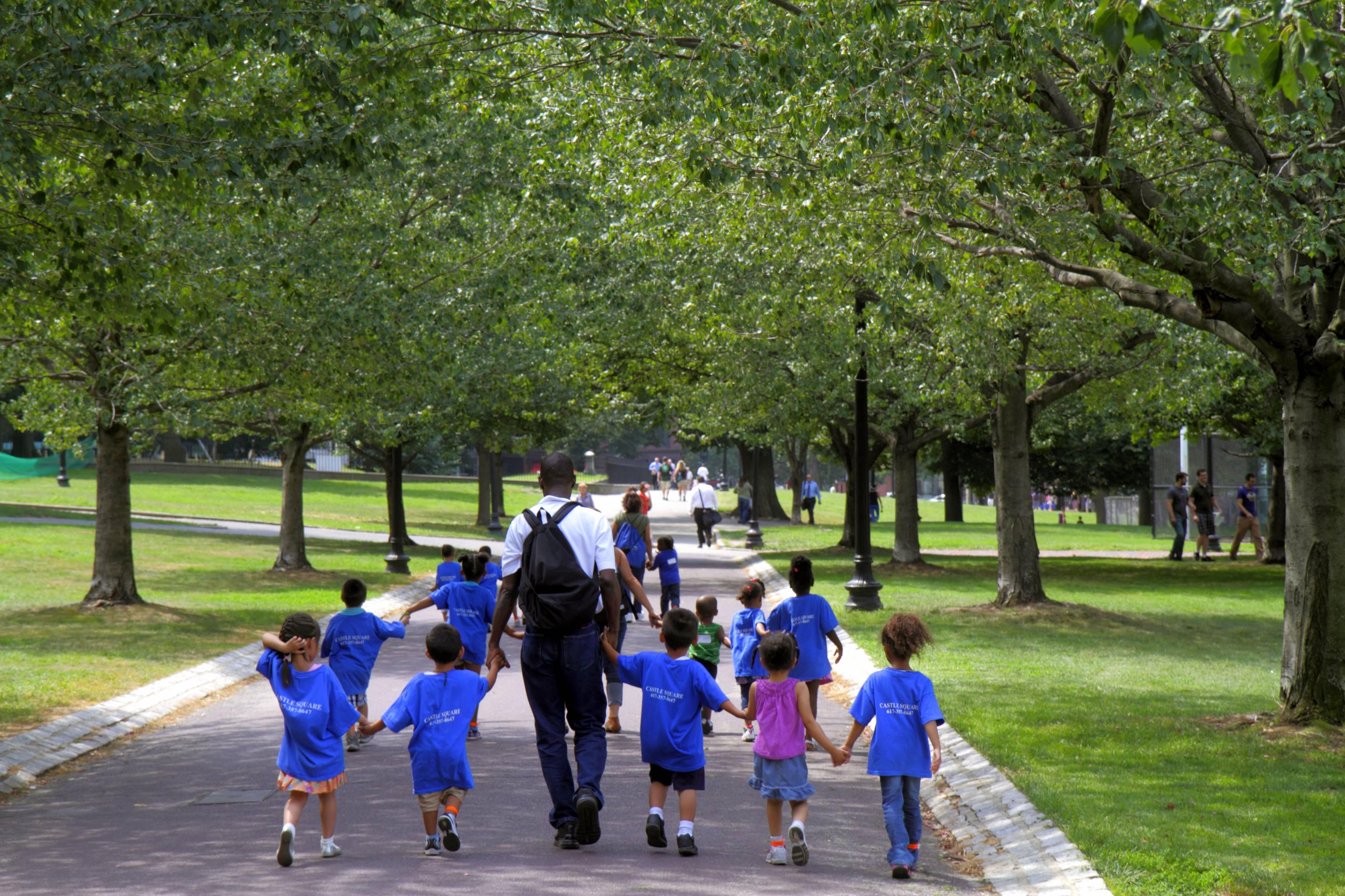 A daycare class walking in a public park in Boston Common.