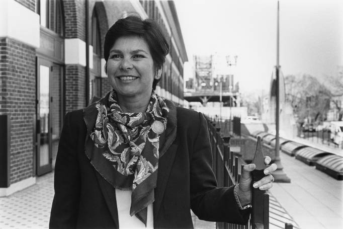 Anita Perez Ferguson standing by fence