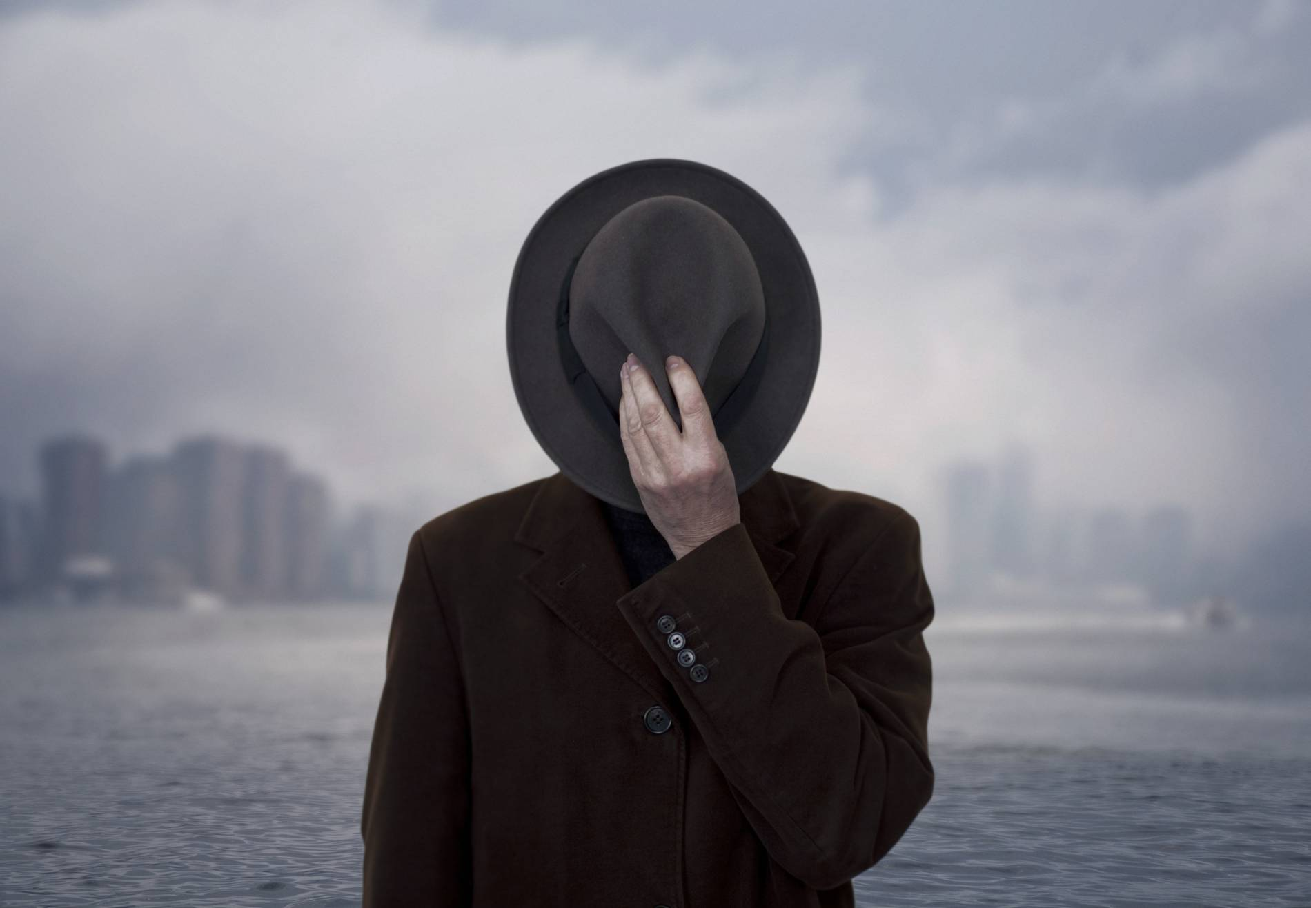 Portrait of a man with face covered by the hat.