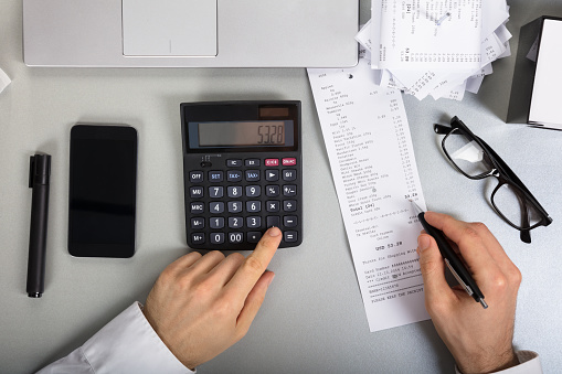 Businessperson Calculating Bill