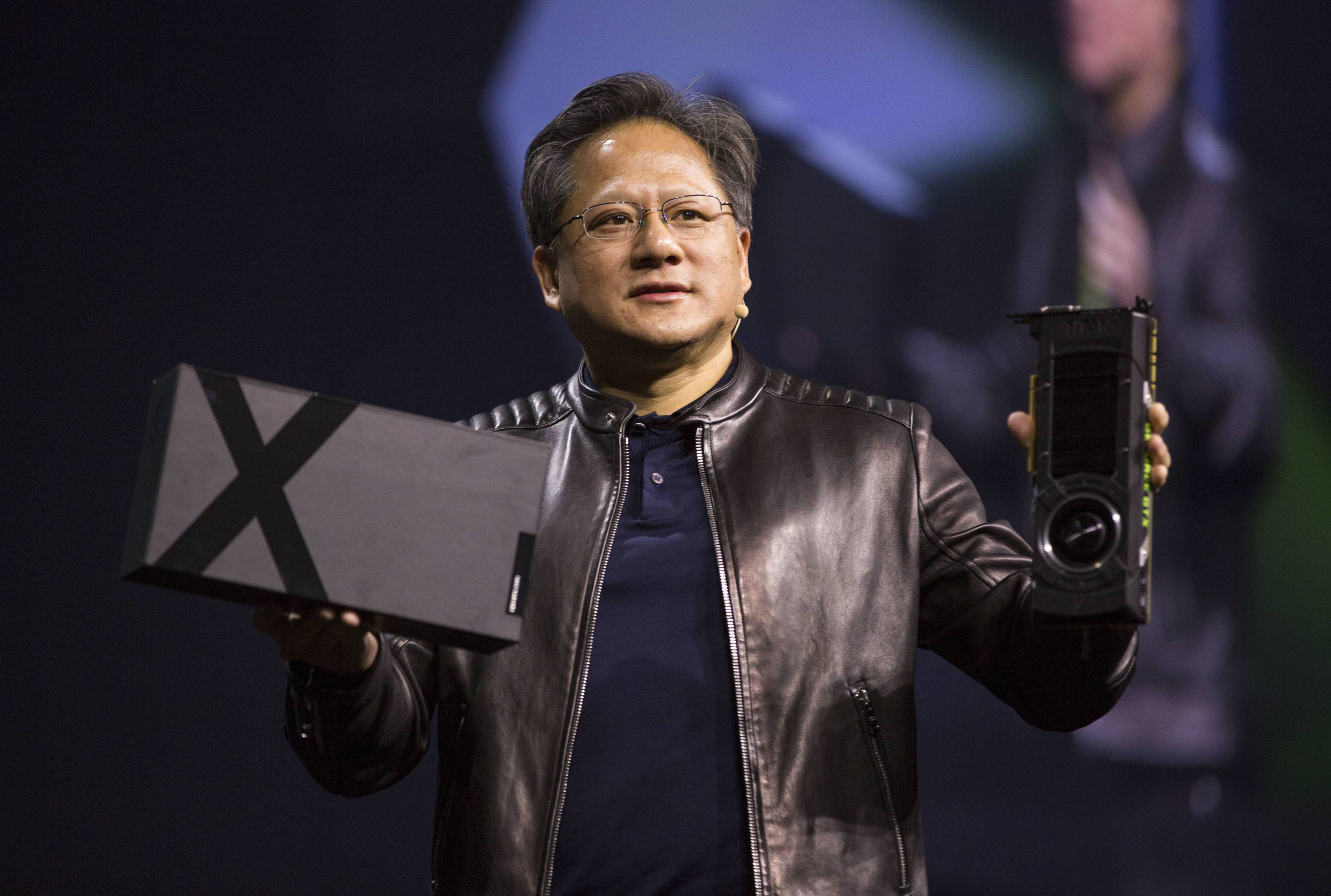 Nvidia CEO Jensen Huang shows off new graphics cards during the GPU Technology Conference in San Jose, Calif.