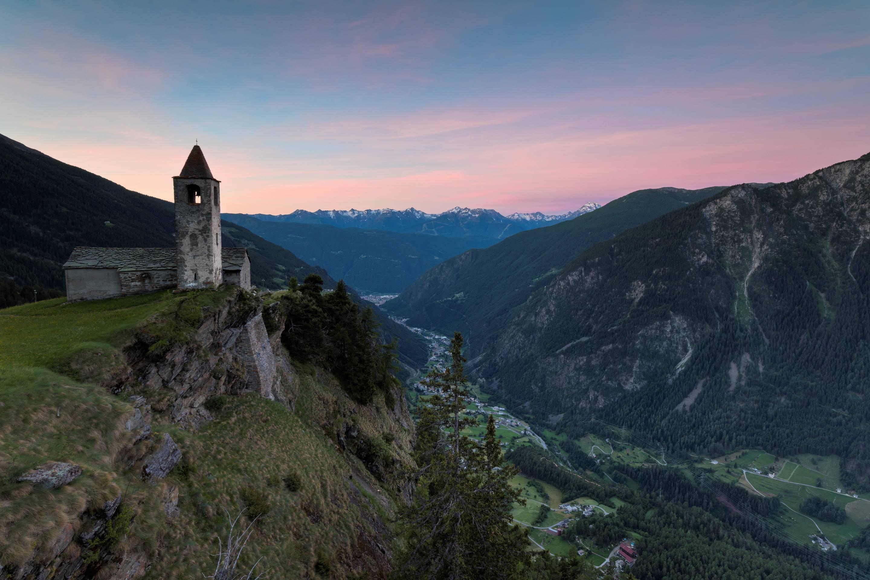 Ancient church at sunrise. San Romerio Alp. Brusio. Canton of GraubŸnden. Poschiavo valley. Switzerland. Europe