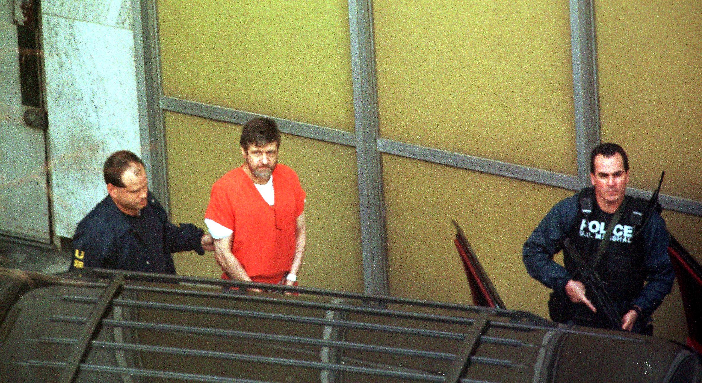 Ted Kaczynski, commonly known as the Unabomber, is led out of court on Jan. 22, 1998.