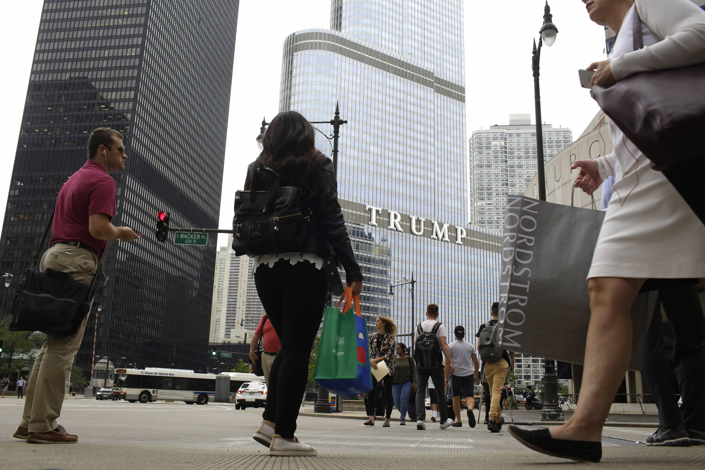 CHICAGO, IL - JULY 31 : Pedestrians walk near Trump Internation