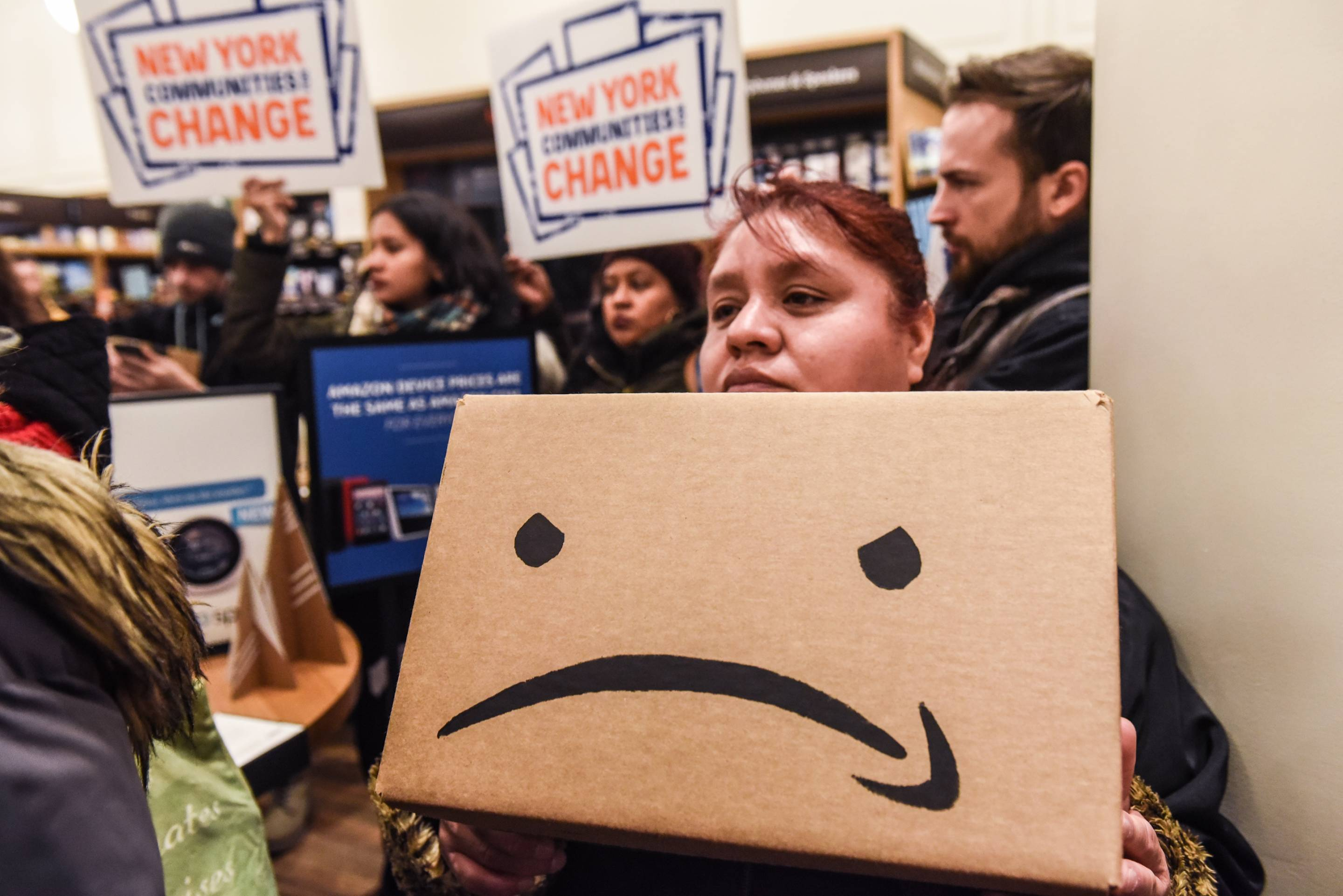 """Protestors In New York City Hold """"Day Of Action"""" Against Amazon HQ2"""