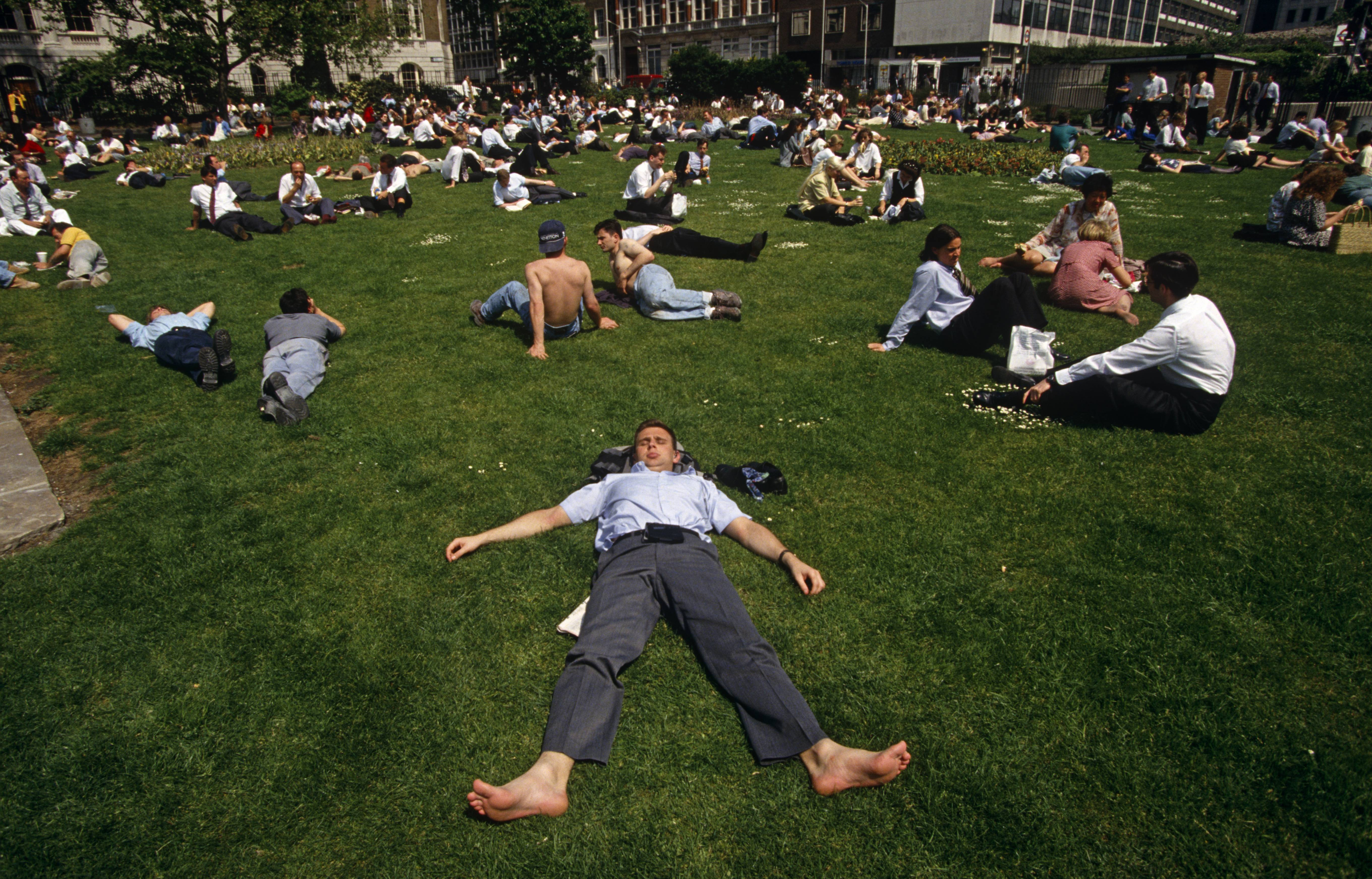 England - London - City office worker sunbathe during hot lunchtime