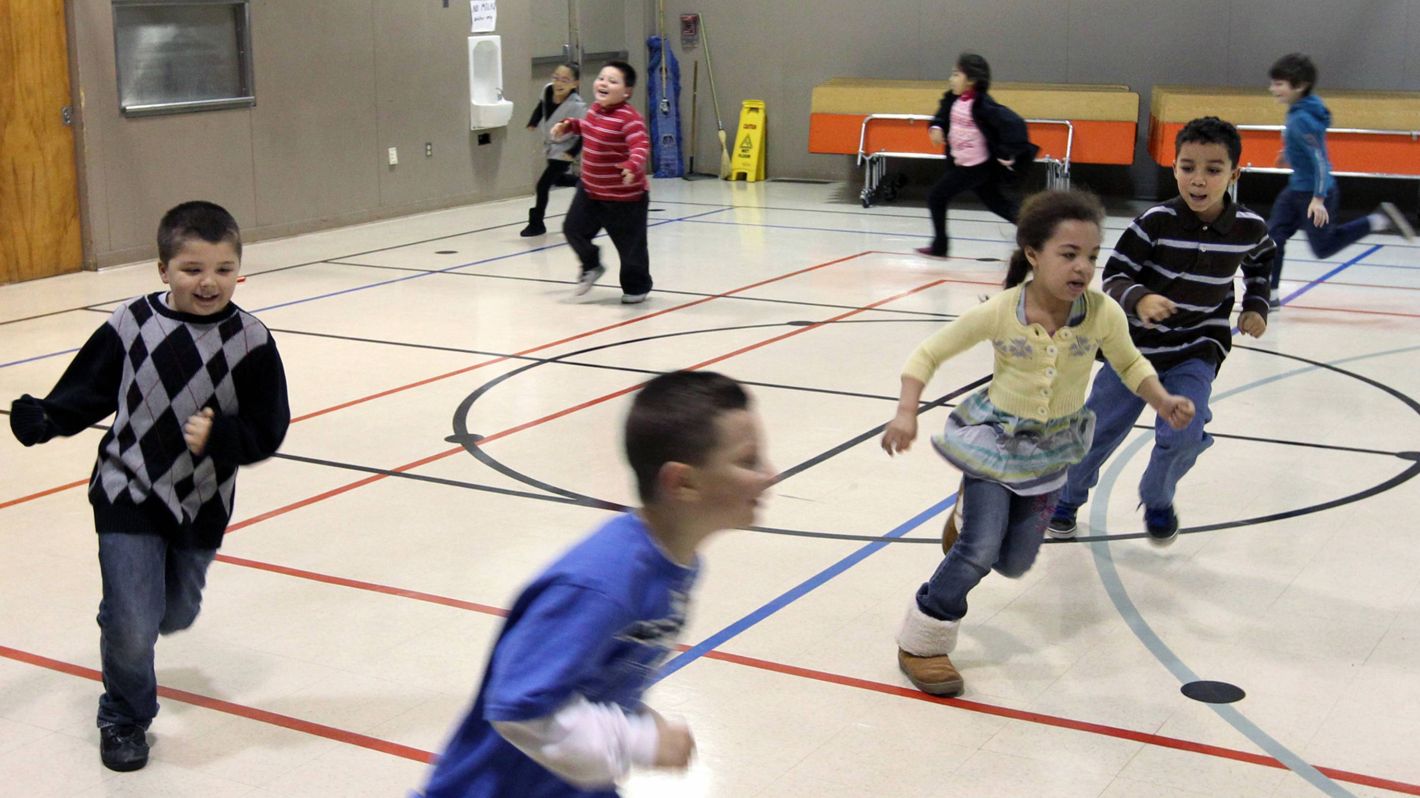 Second graders at Brookdale Elementary School run laps around the gym during a physical education class in Parkland, Wash., on Jan. 3, 2012.