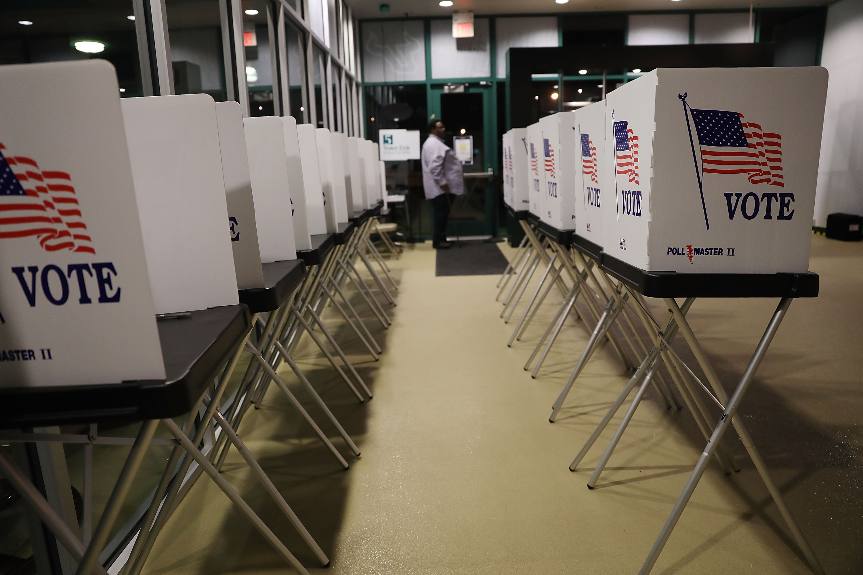 Voting booths are setup at the Yuengling center on the campus of University of South Florida as workers prepare to open the doors to early voters on October 22, 2018 in Tampa, Florida. Florida voters head to the polls to cast their early ballots in the race for the Senate as well as the Governors seats.
