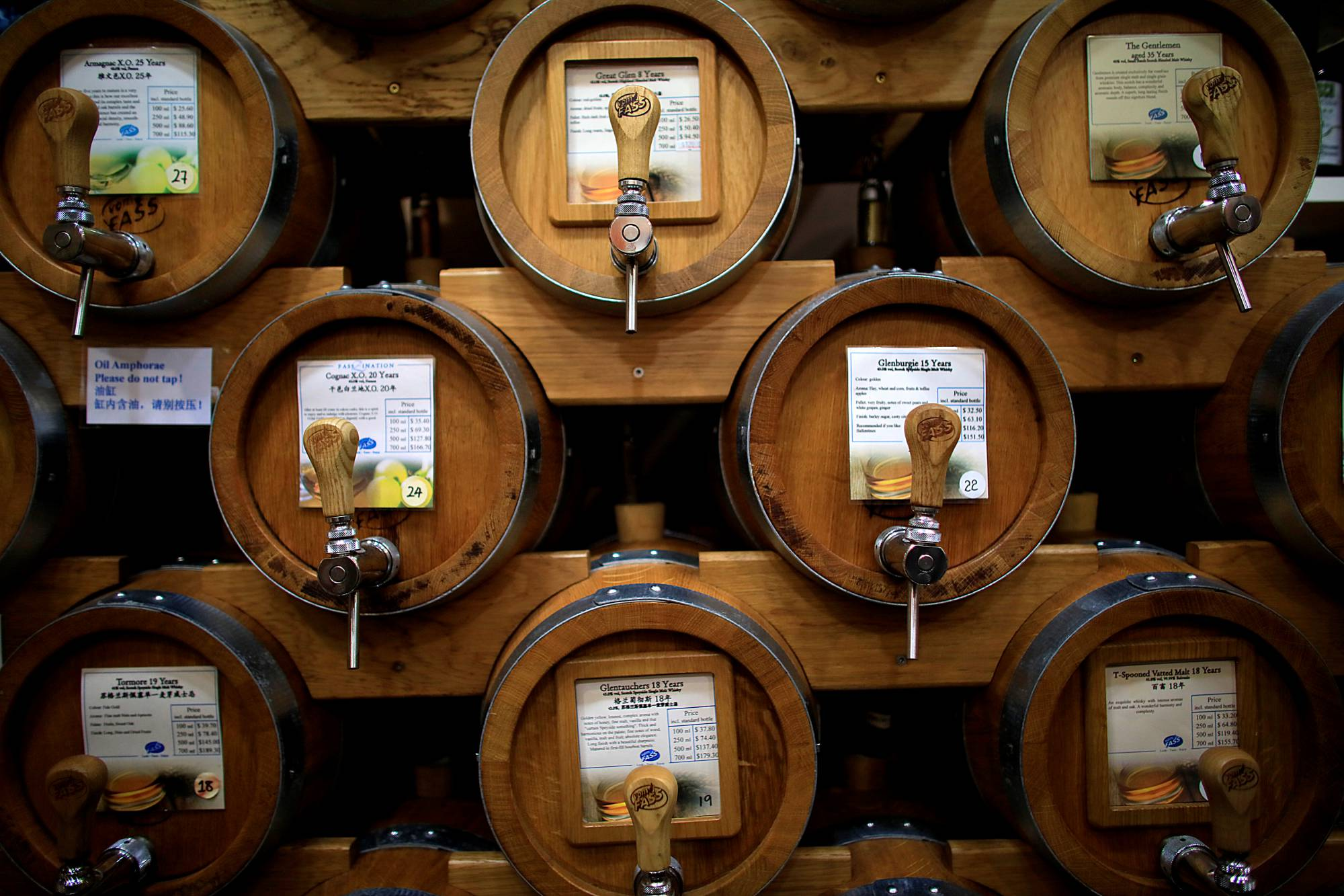 Vats of whisky are seen in a specialty shop in Singapore