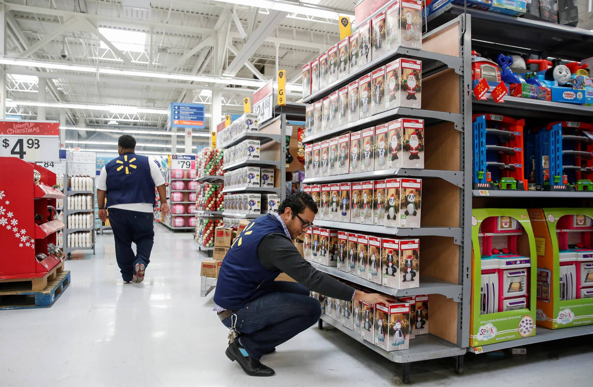 An employee works on a display ahead of Black Friday at a Walmart store in Chicago