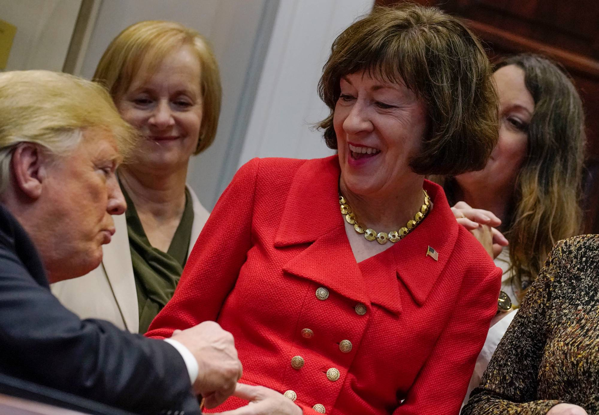 "U.S. President Trump greets Senator Collins during signing ceremony for the ""Know the Lowest Price Act"" and the ""Patients Right to Know Drug Prices Act"" at the White House in Washington"
