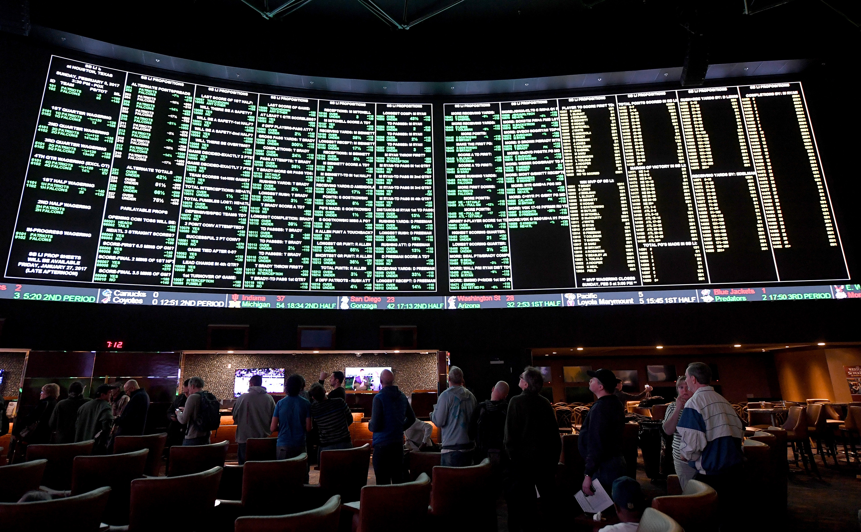 Bettors line up to wager on Super Bowl LI between the Atlanta Falcons and the New England Patriots at the Westgate Las Vegas Resort & Casino on Jan. 26, 2017.