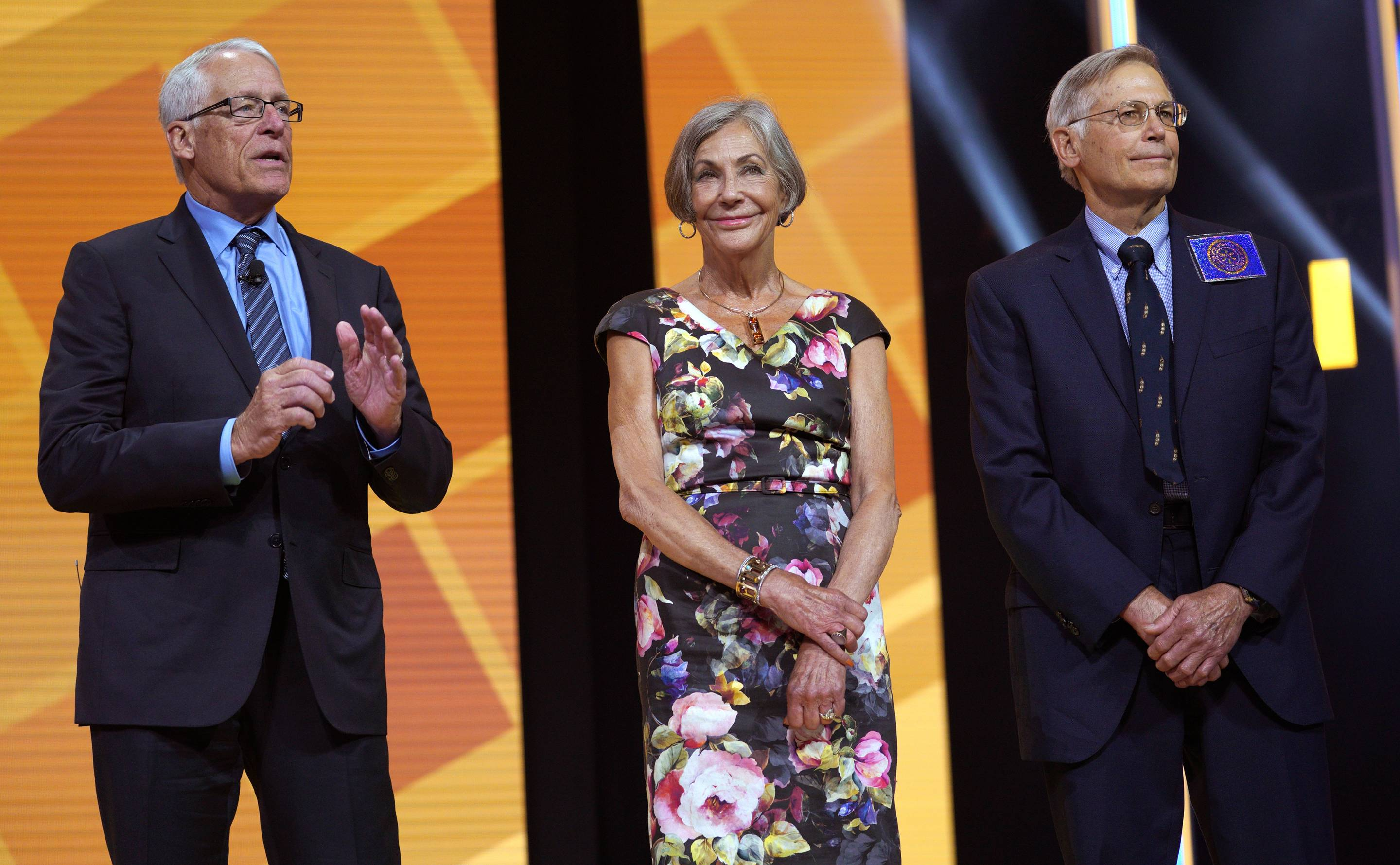 Members of the Walton family, Rob, Alice, and Jim (from left to right), speak during the annual Walmart shareholders meeting on June 1, 2018 in Fayetteville, Ark.