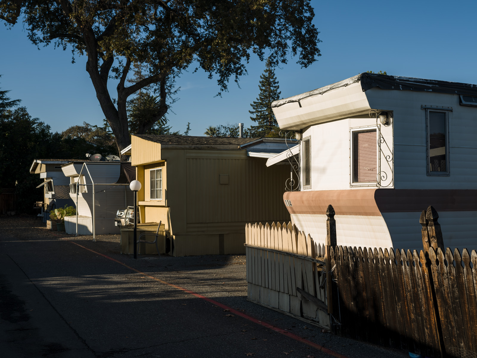 The sun sets on the trailers in the Buena Vista Mobile Home Park. The park offers one of the only affordable housing options in Palo Alto, where the median home price is $3.2 million.