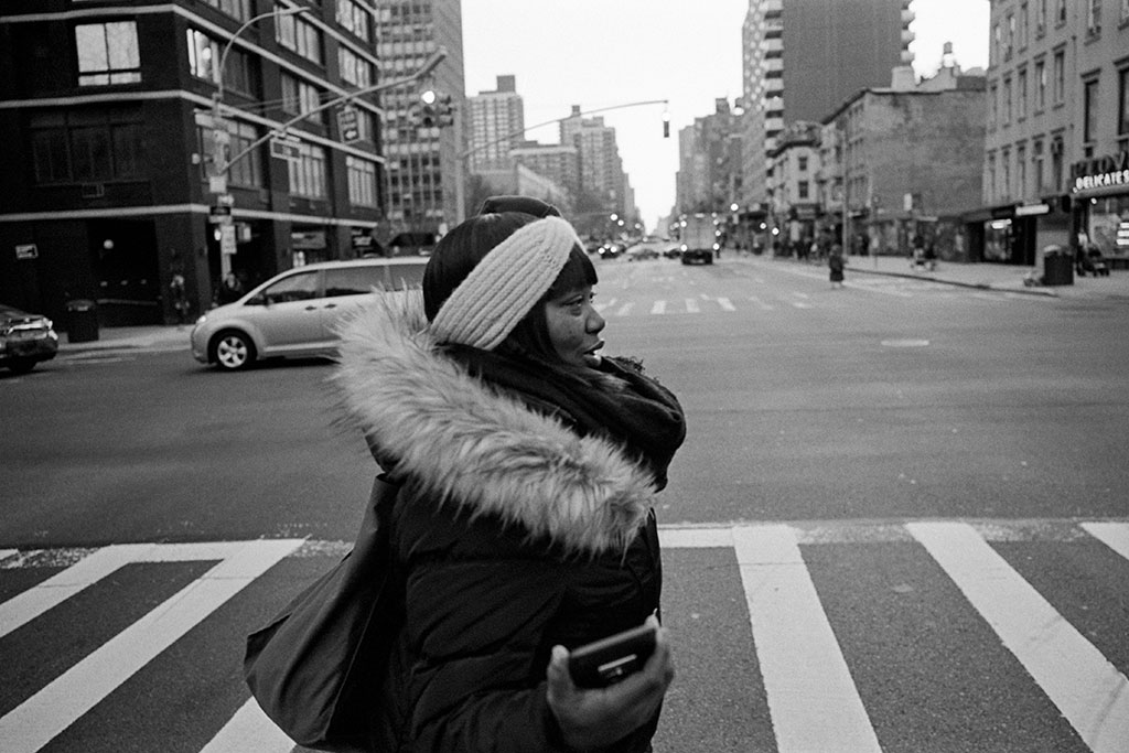 Kamik Chin walks to the subway after completing a day of work in Midtown Manhattan.