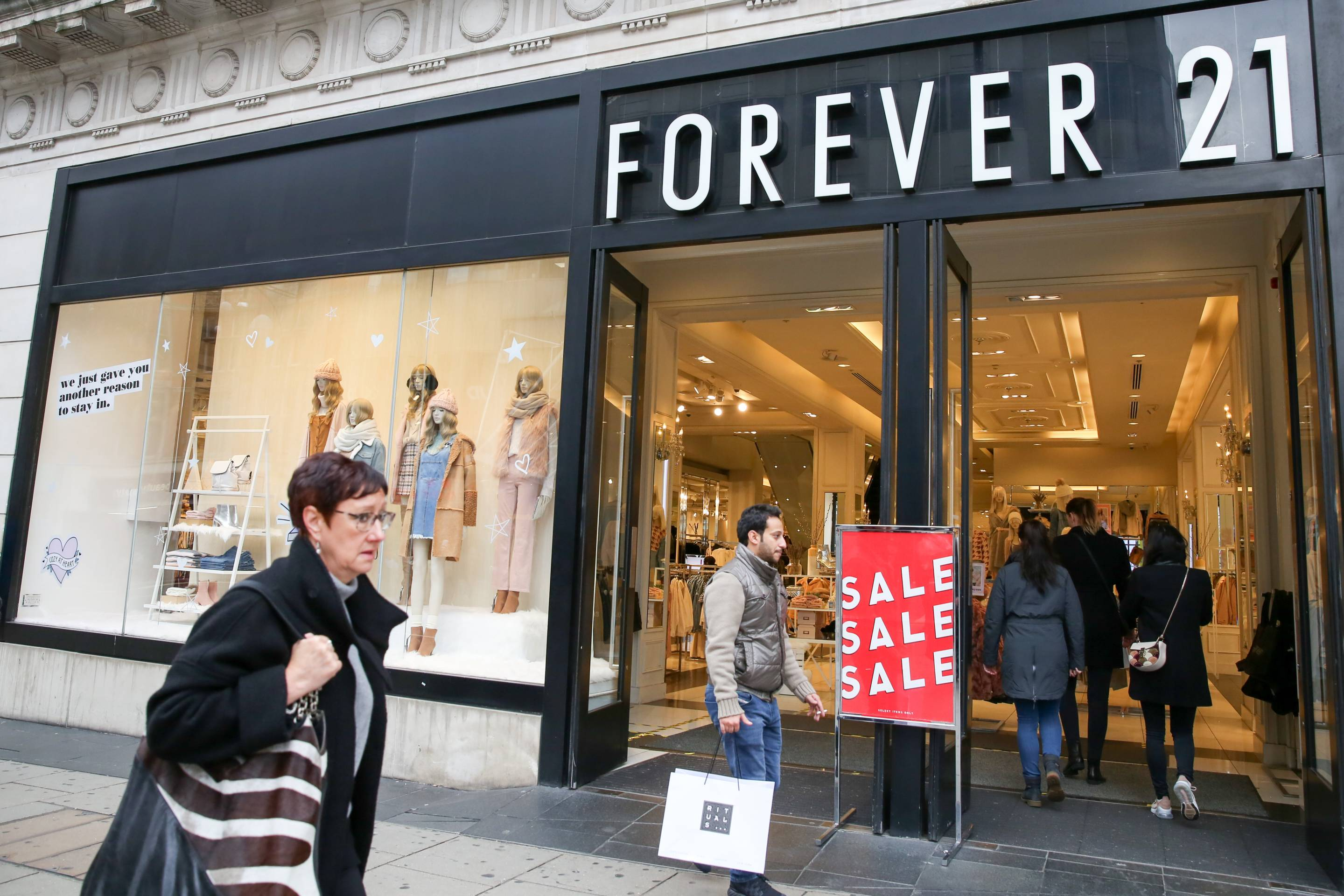 Shoppers are seen outside Forever 21 store on London's
