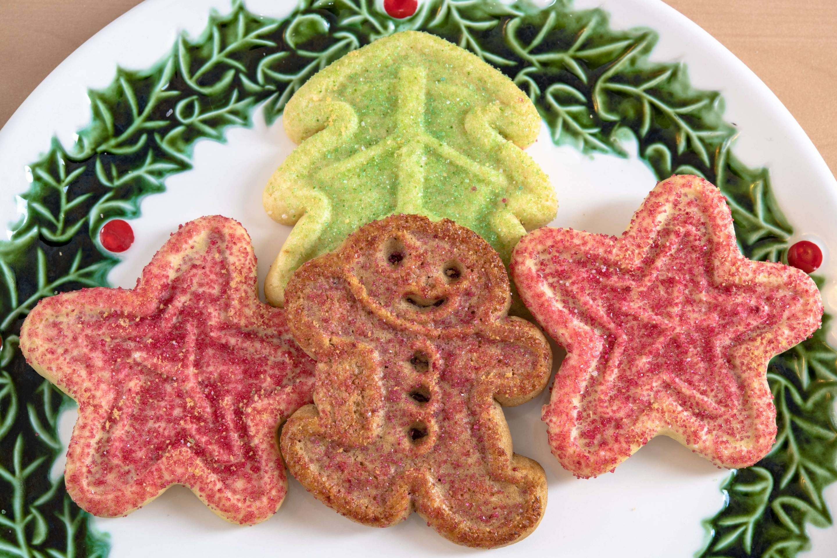 Gingerbread surrounded by other colorful cookies. High angle