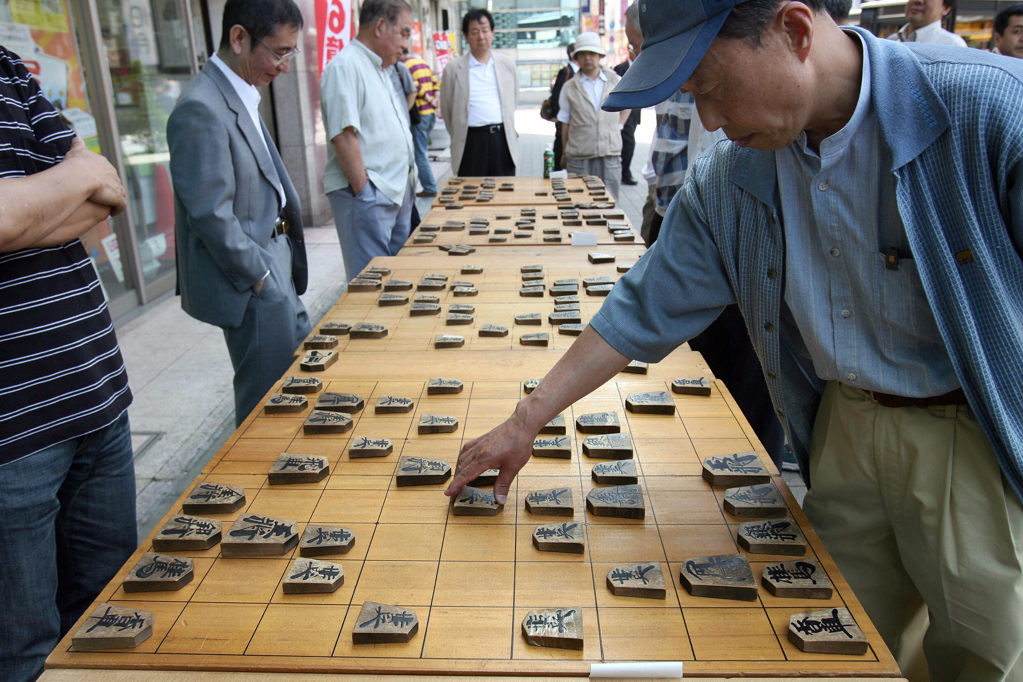 "People play the ""shogi"" or Japanese ches"