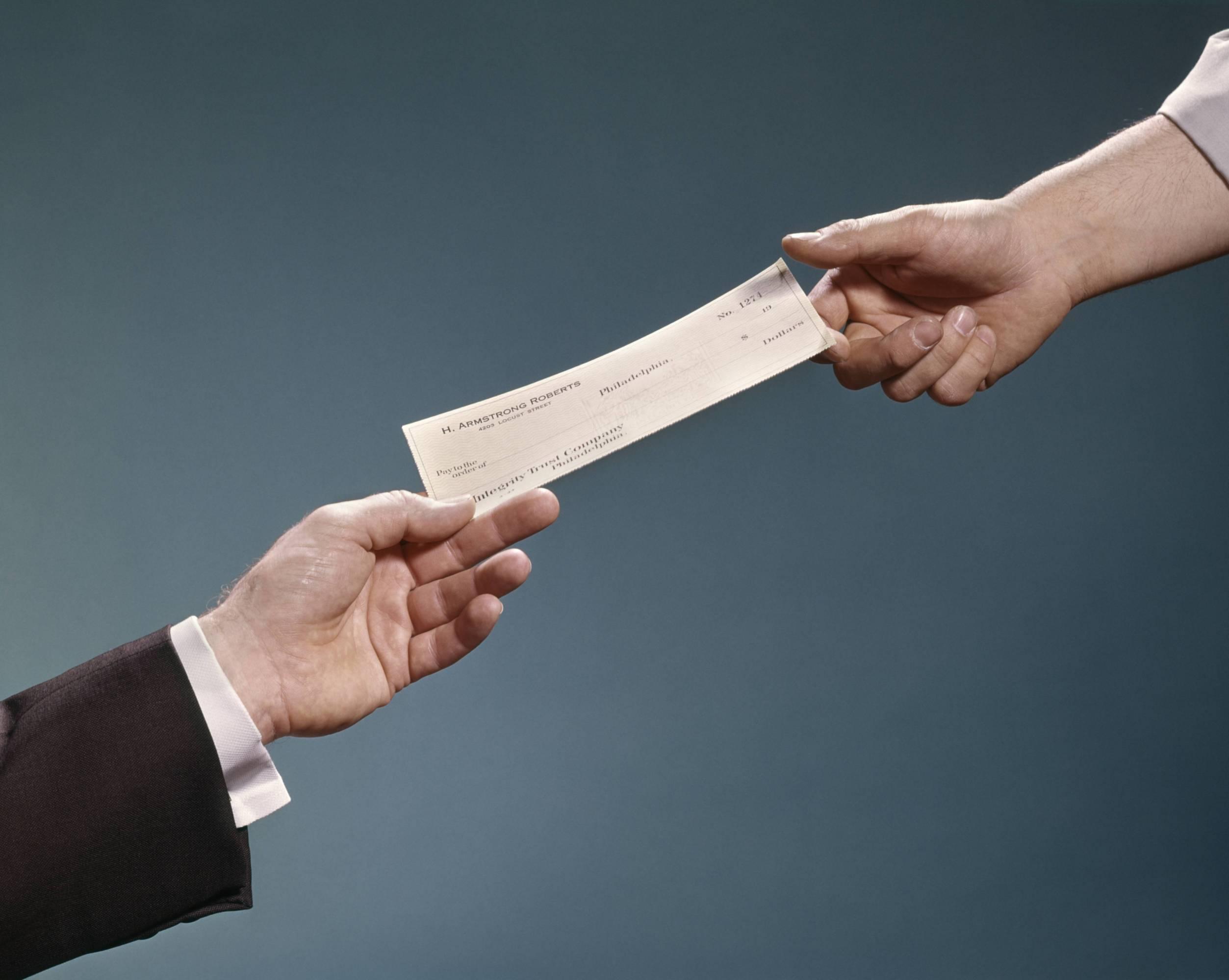 EMPLOYERS HAND HANDING...
