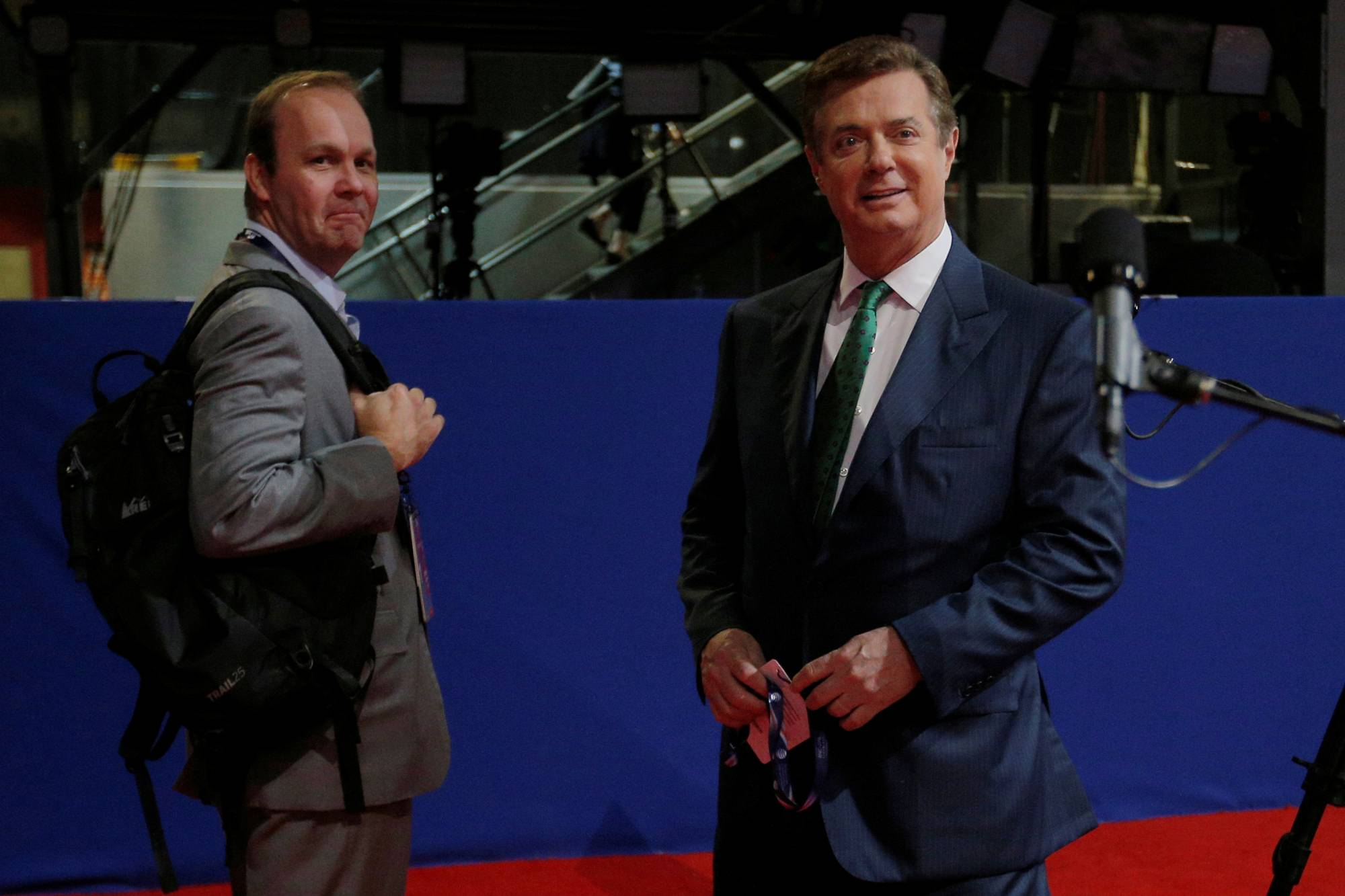 Paul Manafort and Rick Gates stand on the floor of the Republican National Convention in Cleveland
