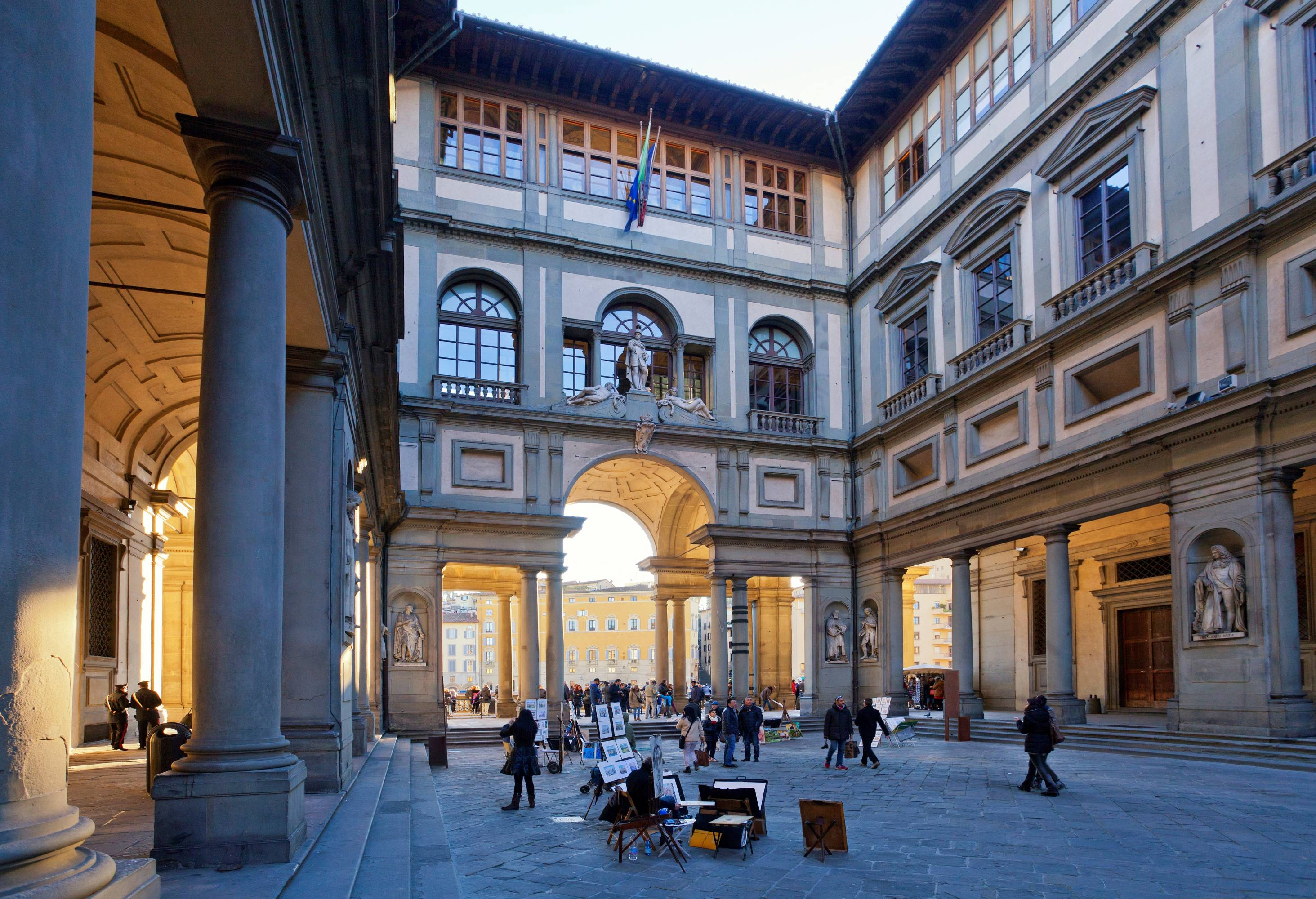 Galleria degli Uffizi museum. narrow courtyard between palace's two wings with view toward the Arno. Florence. Tuscany. Italy