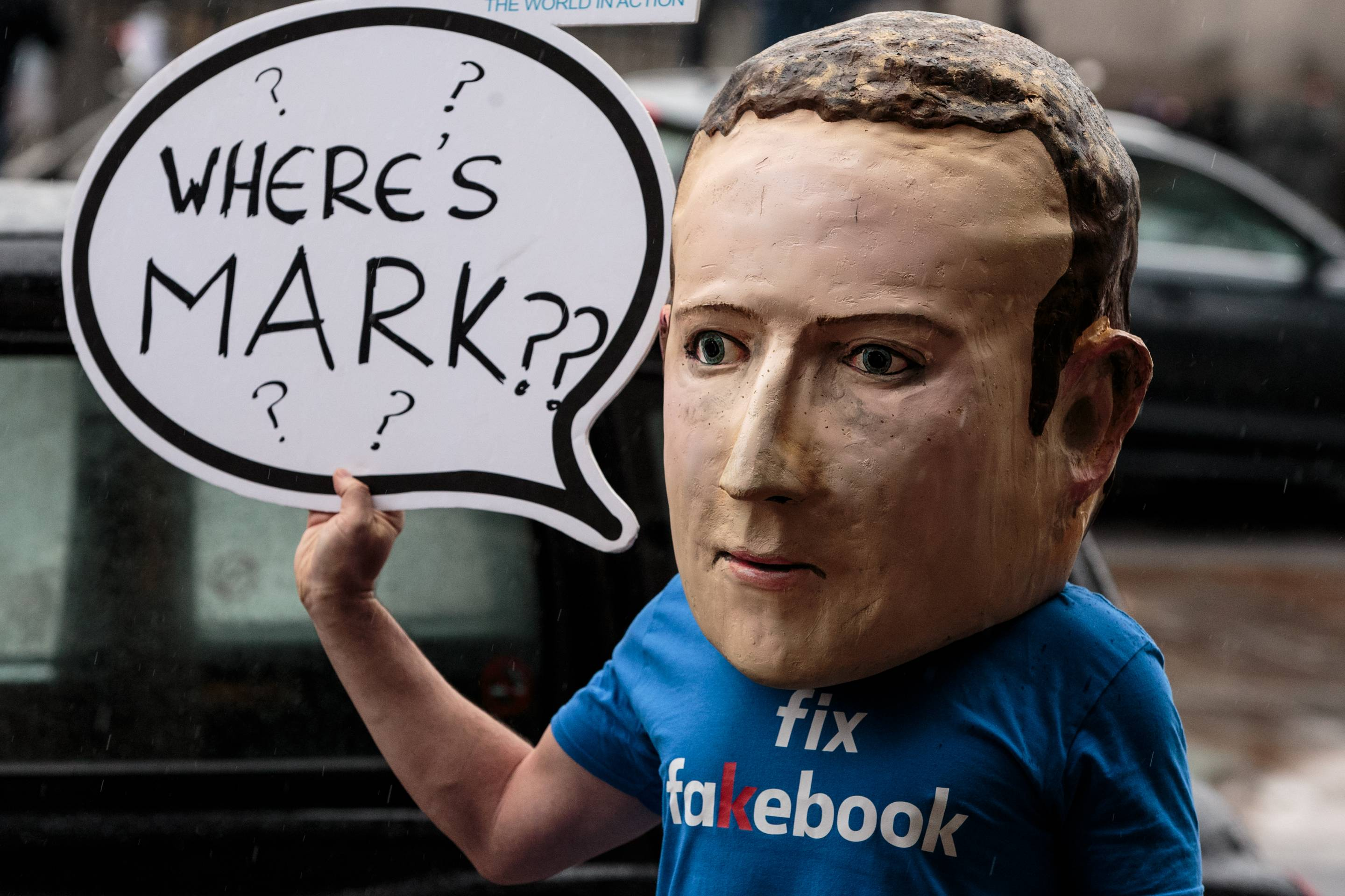 A protester wearing a model head of Facebook CEO Mark Zuckerberg poses for media on Nov. 27, 2018 in London.