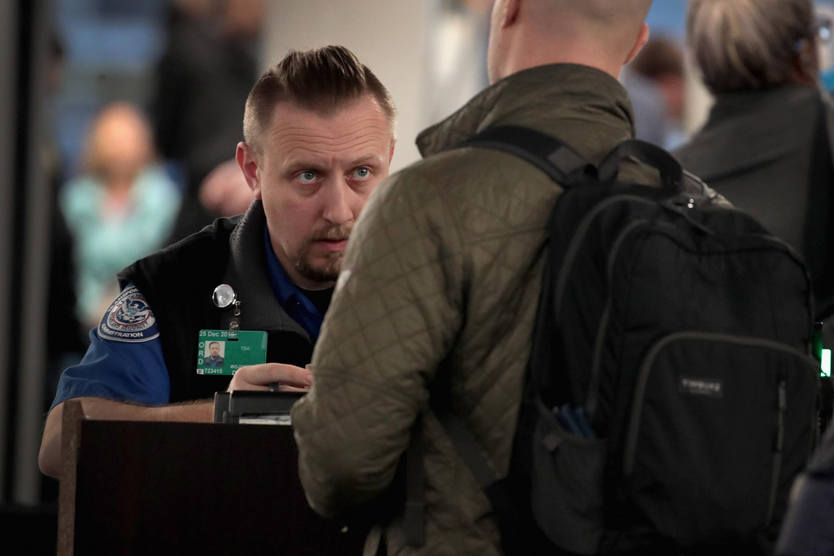 TSA Agents Work At Airport Security As Government Shutdown Continues