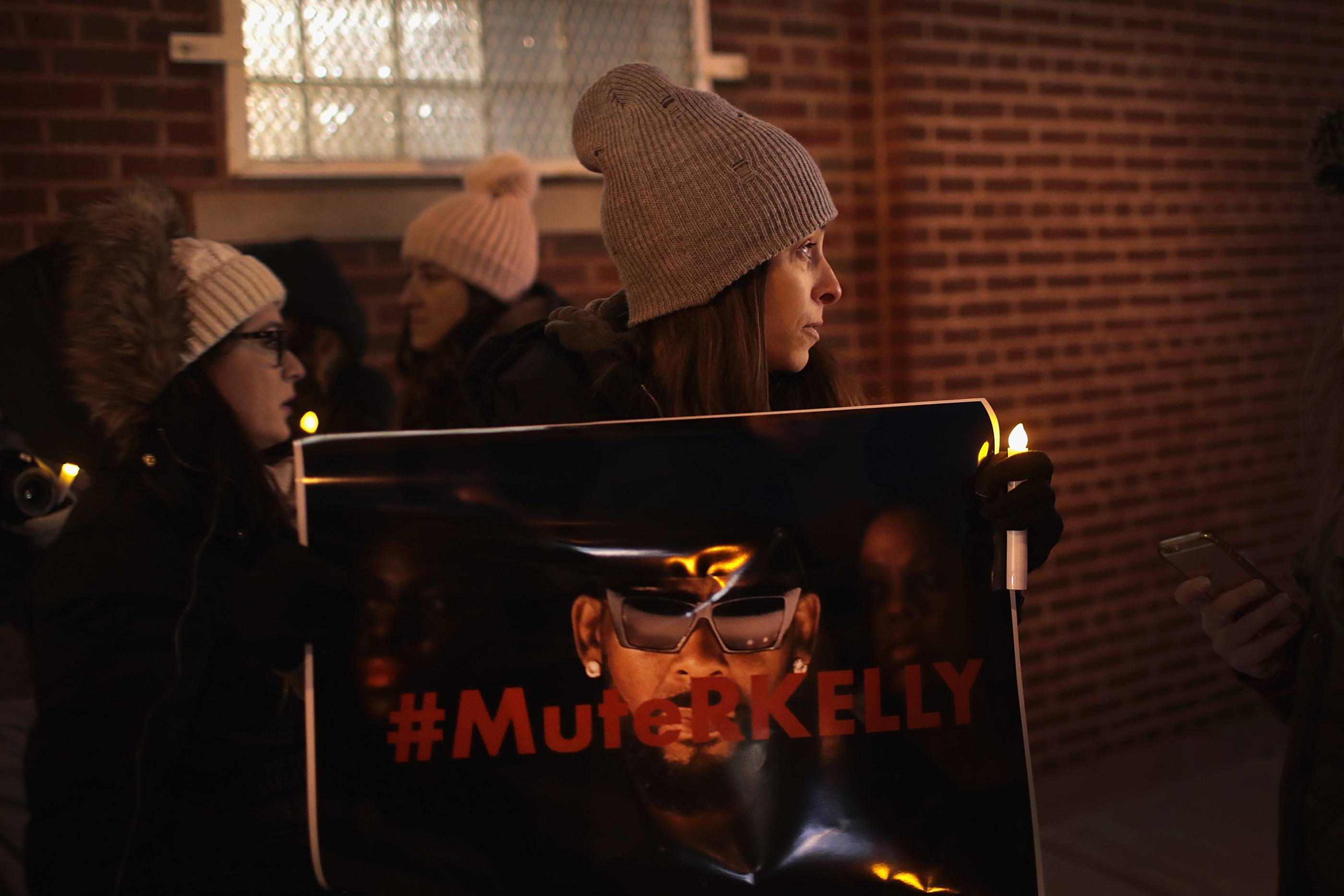 Protestors Rally In Support Of Sex Abuse Survivors At R Kelly's Chicago Studios